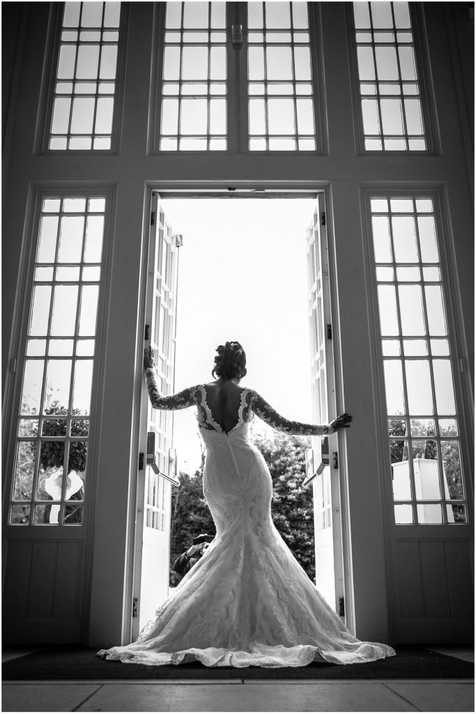 Highcliffe Castle Wedding Bride in front of Double Height windows
