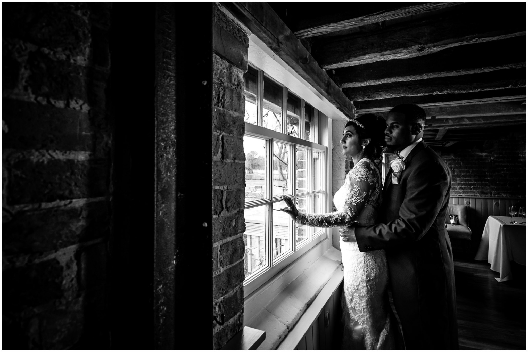 Sopley Mill Wedding Reception Bride & Groom in front of window
