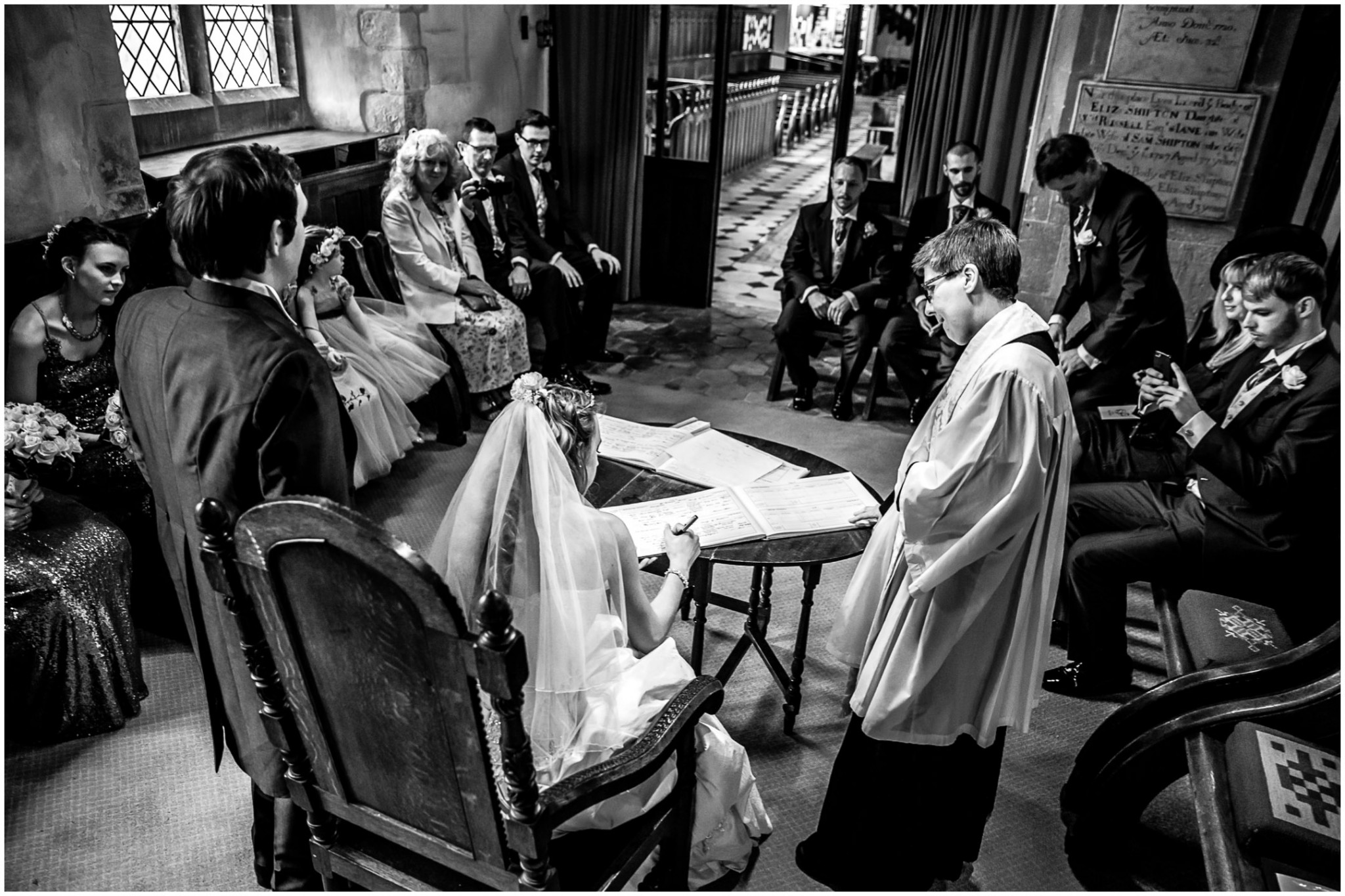 Highfield Park Wedding Photography Bride & Groom signing the register