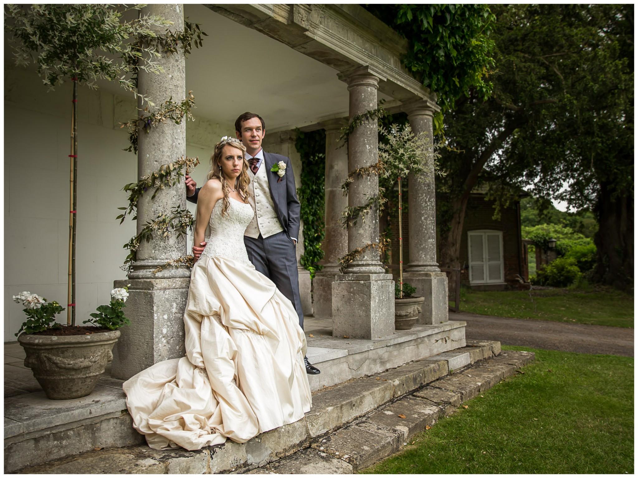 Highfield Park Wedding Photography Bride and Groom by pillar