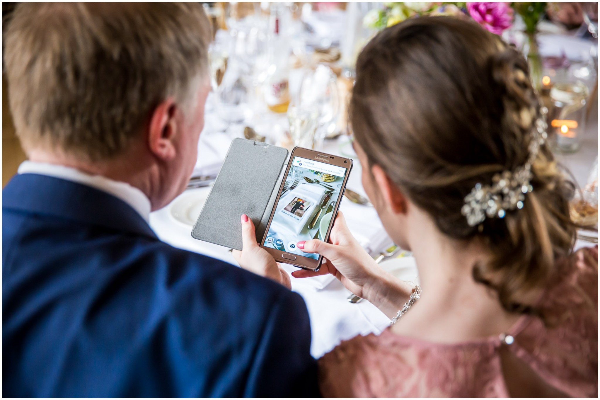 Wasing Park Wedding Photography guest taking photos of table decorations