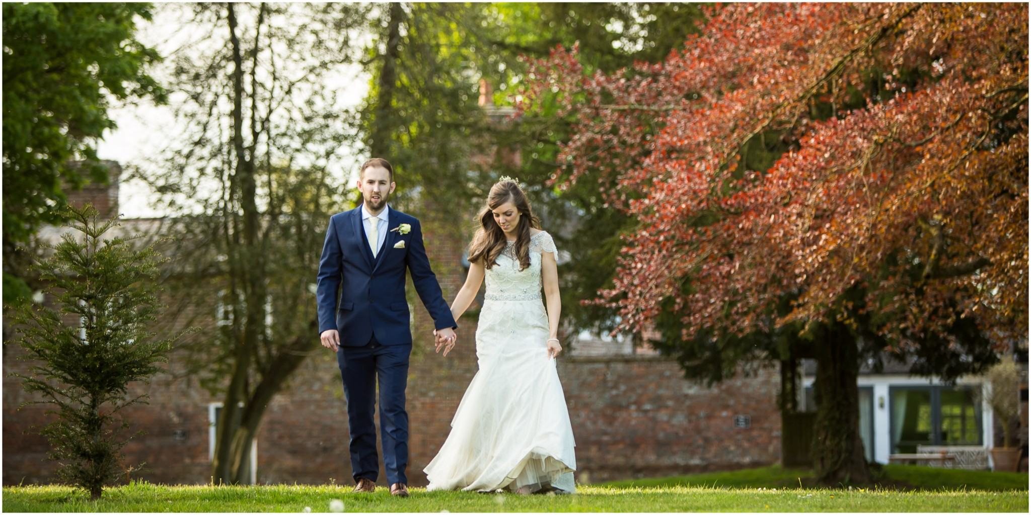 Wasing Park Wedding Photography Bride & Groom walking in the gardens