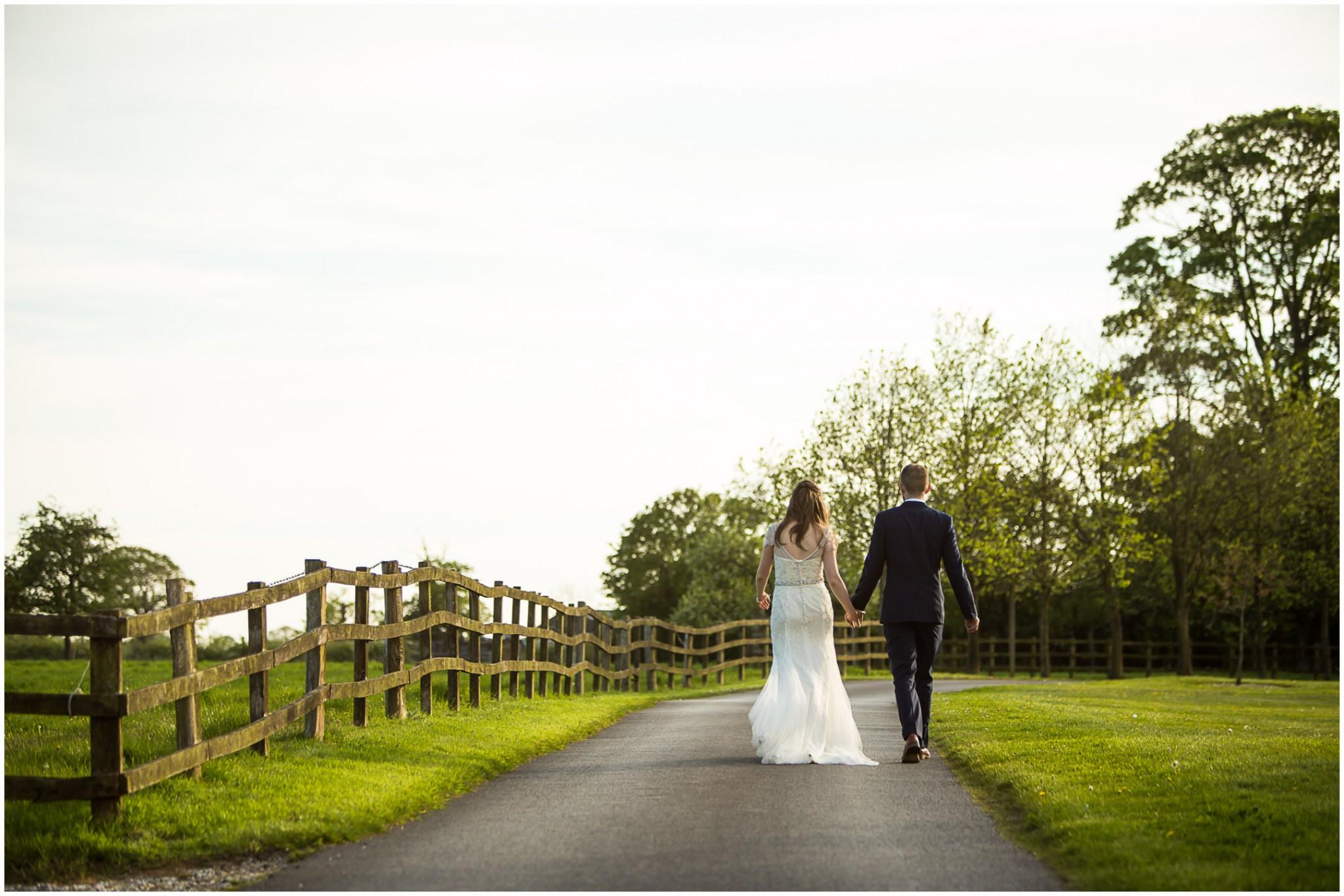 Wasing Park Wedding Photography Bride & Groom walking together