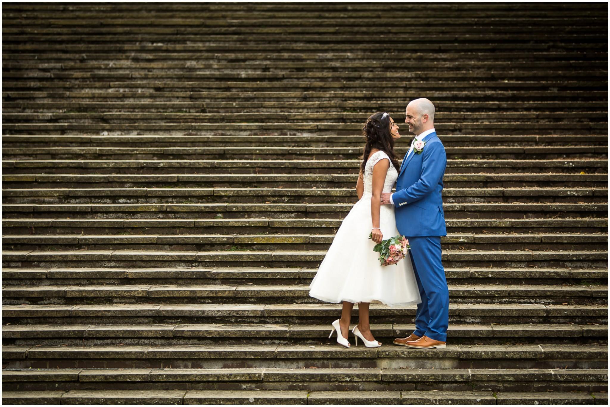 Basing Room wedding photographer Bride & Groom on steps