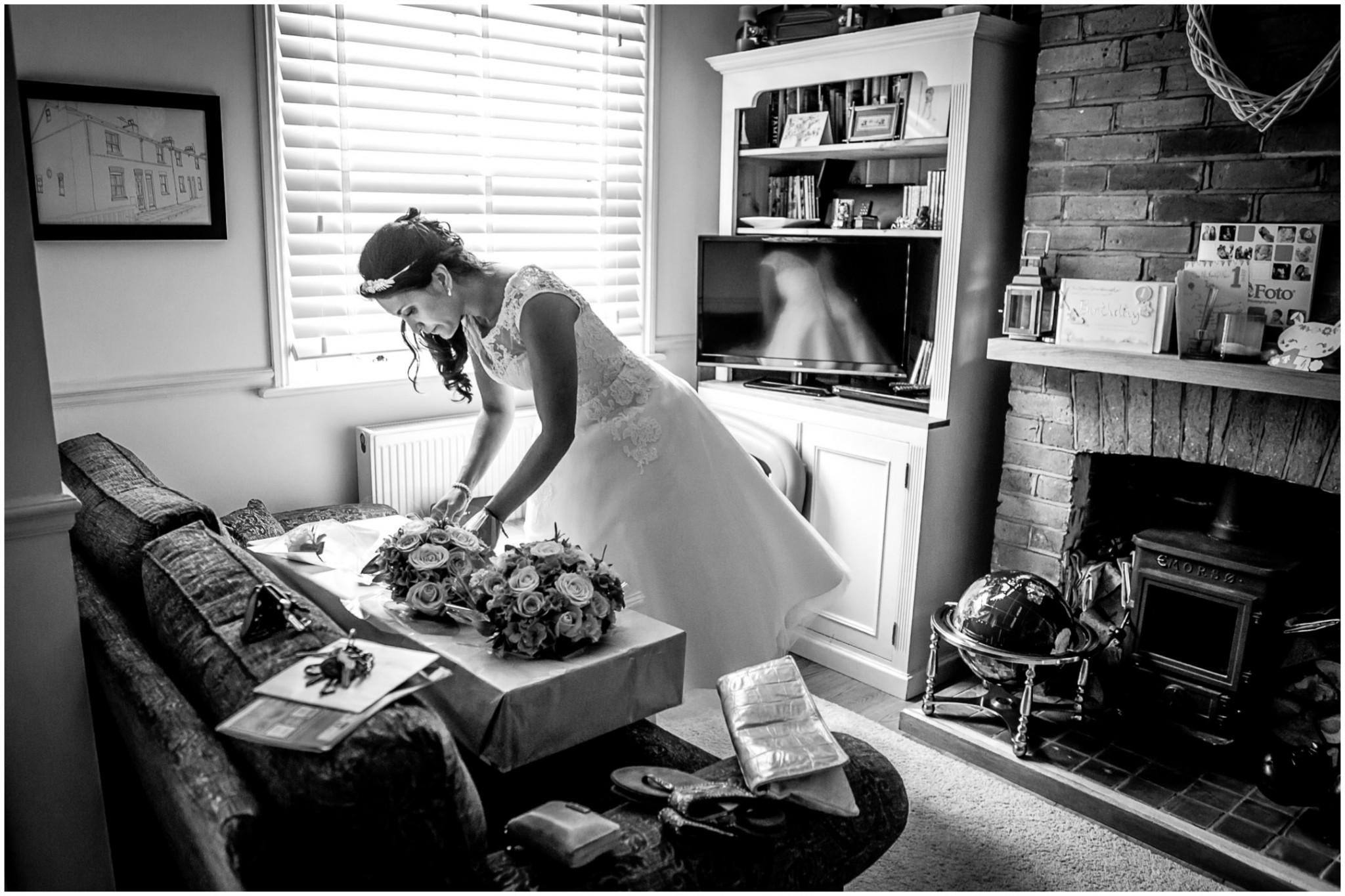 Basing Room wedding photographer Bride arranging flowers