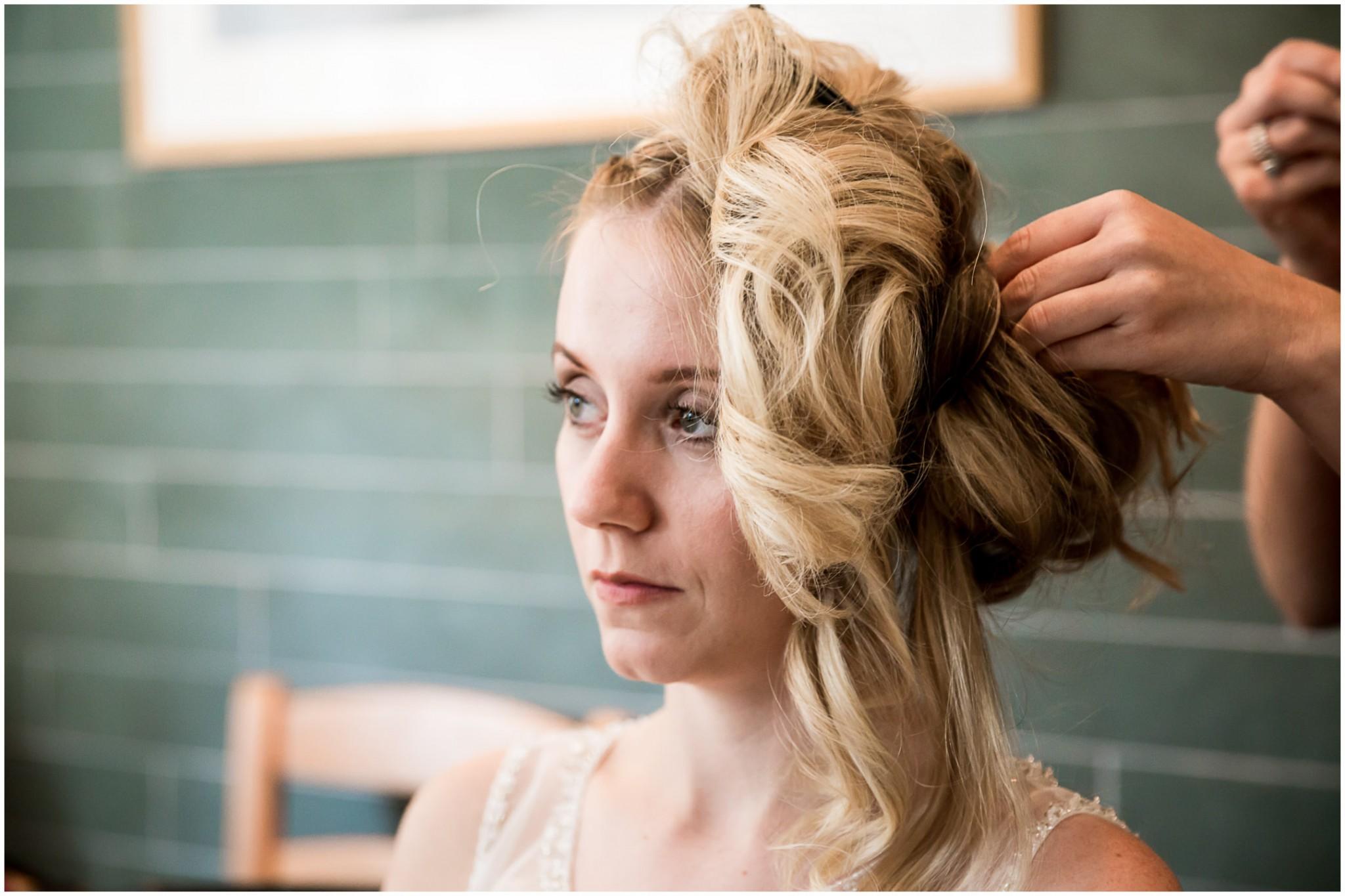 Tournerbury Woods Estate wedding Bride getting hair done