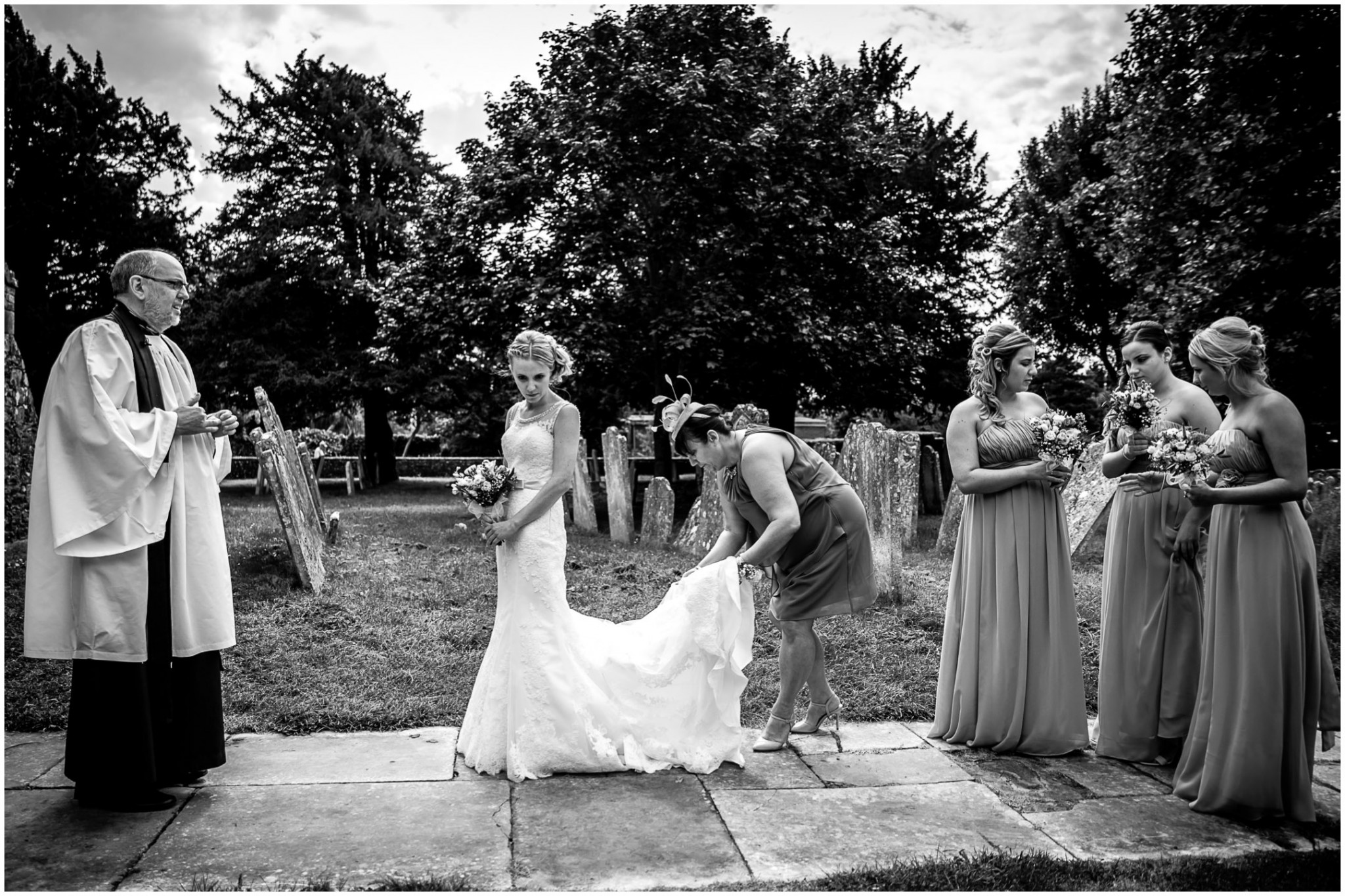 St Thomas a Becket Church Wedding Bride with Bridesmaids outside church