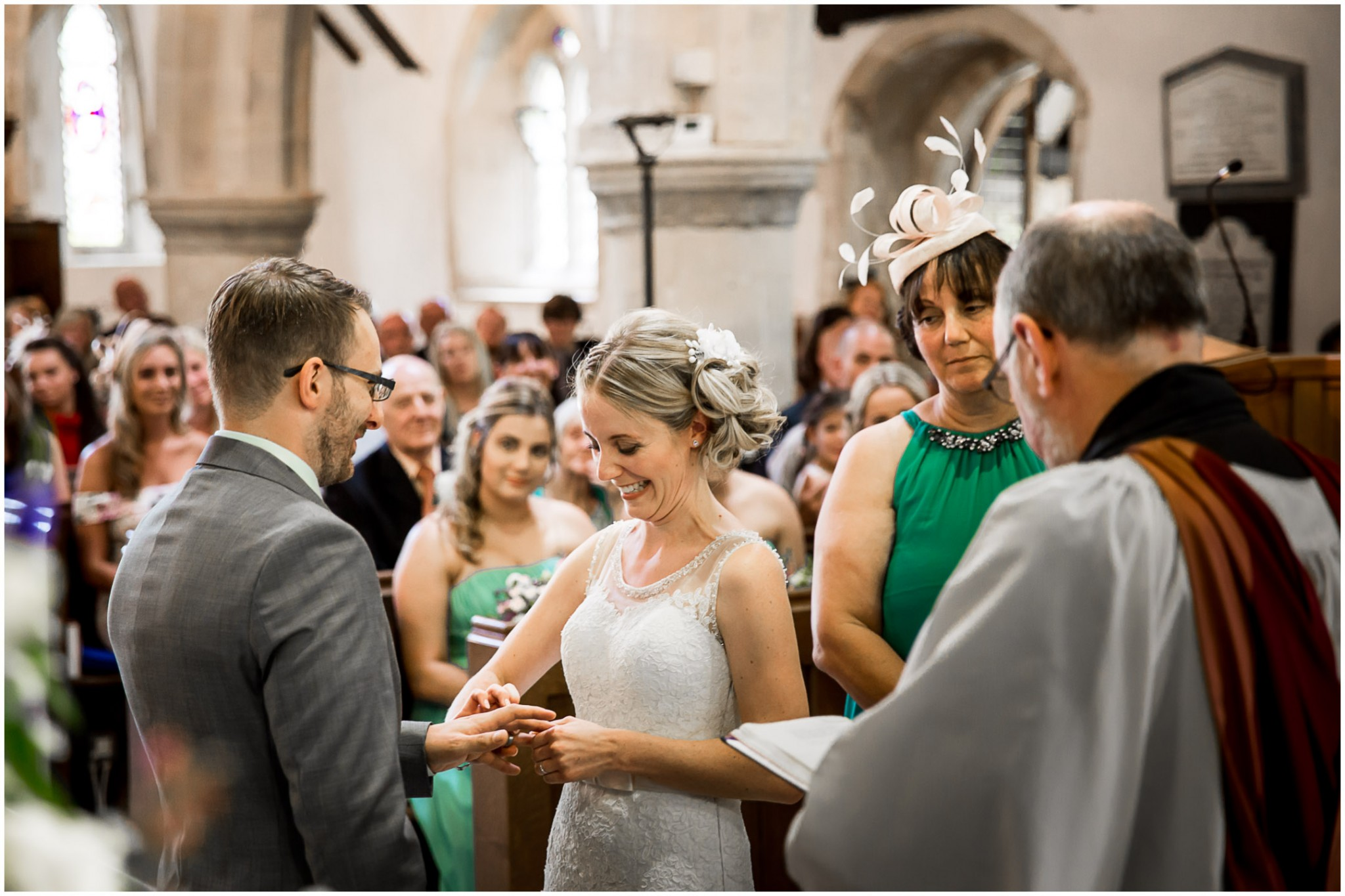 St Thomas a Becket Church Wedding Bride & Groom exchanging rings