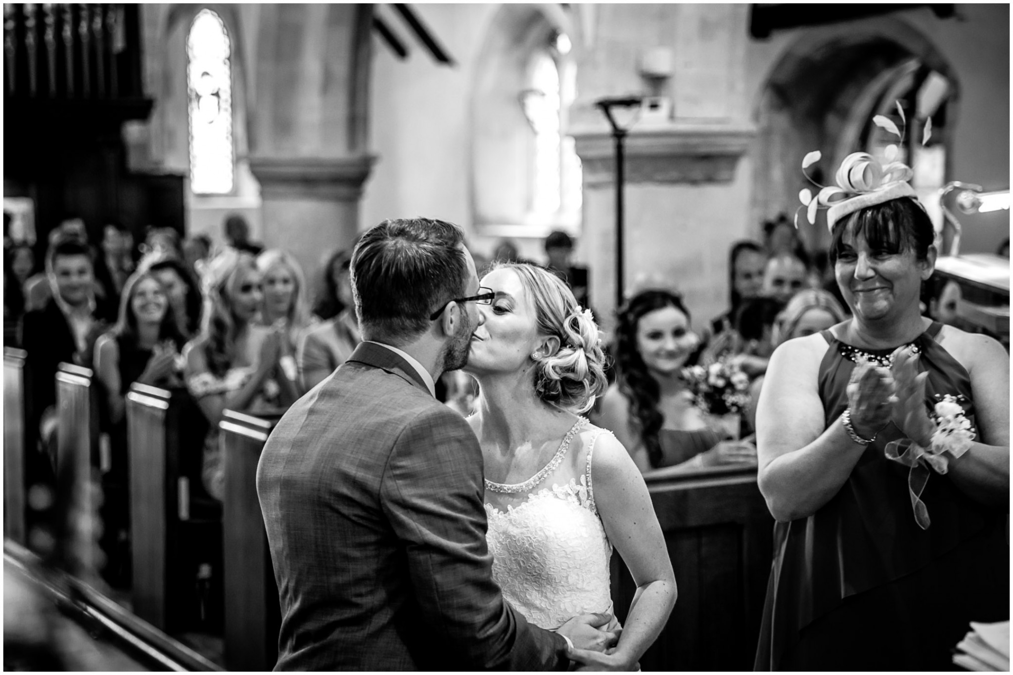St Thomas a Becket Church Wedding Bride & Groom's first kiss