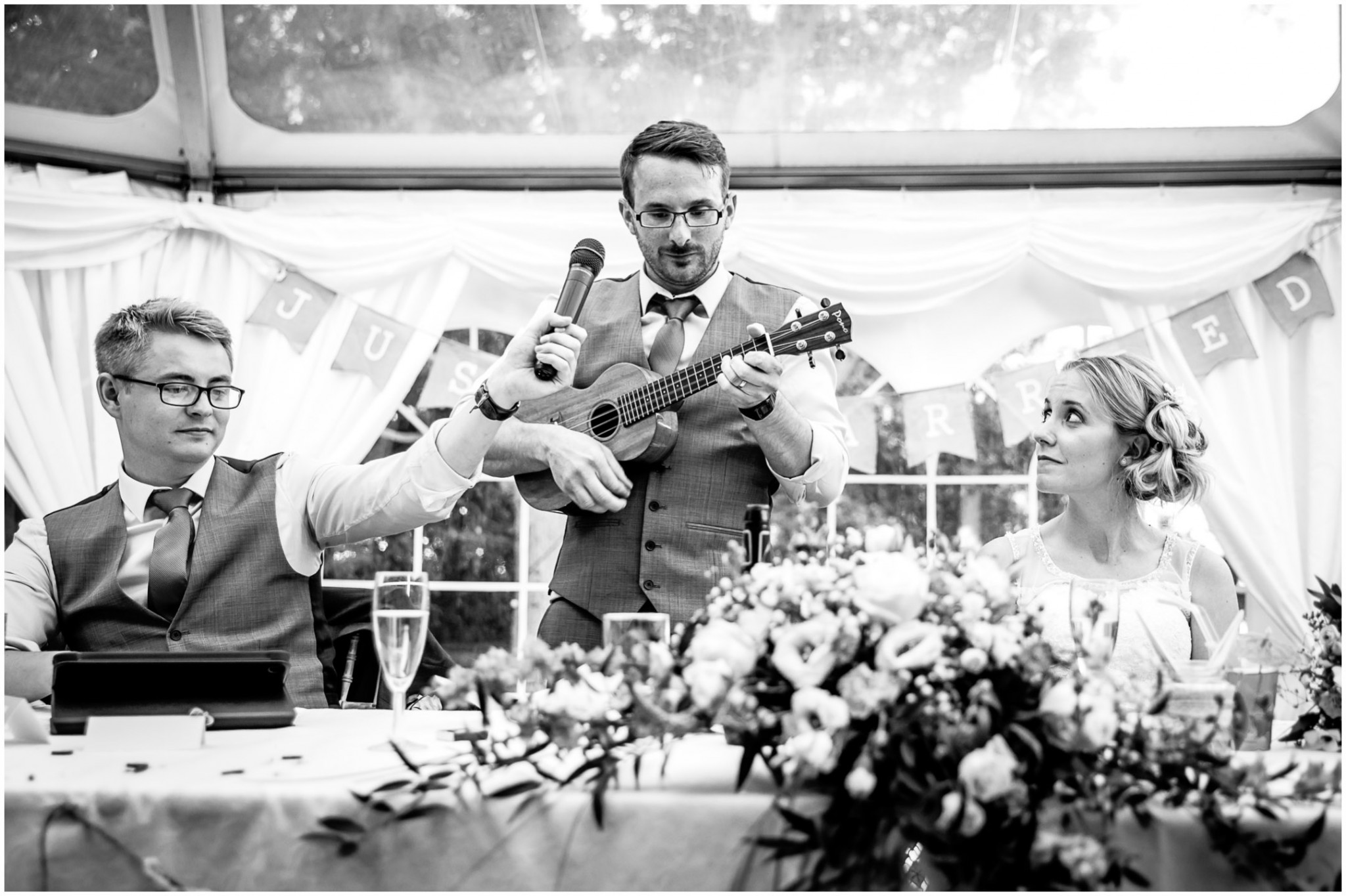 Tournerbury Woods Estate Wedding groom plays ukelele for Bride