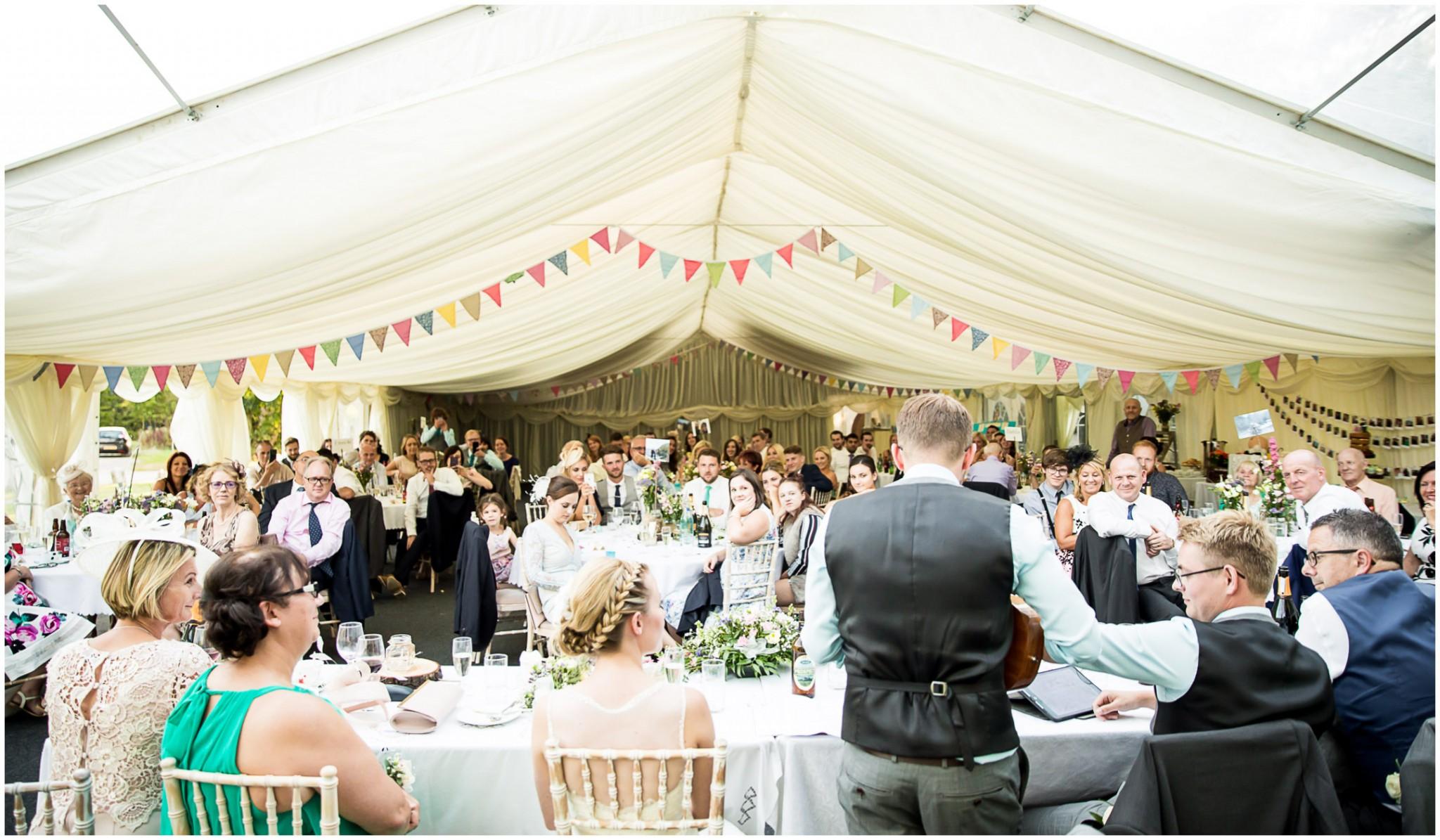 Tournerbury Woods Estate Wedding Groom serenading Bride