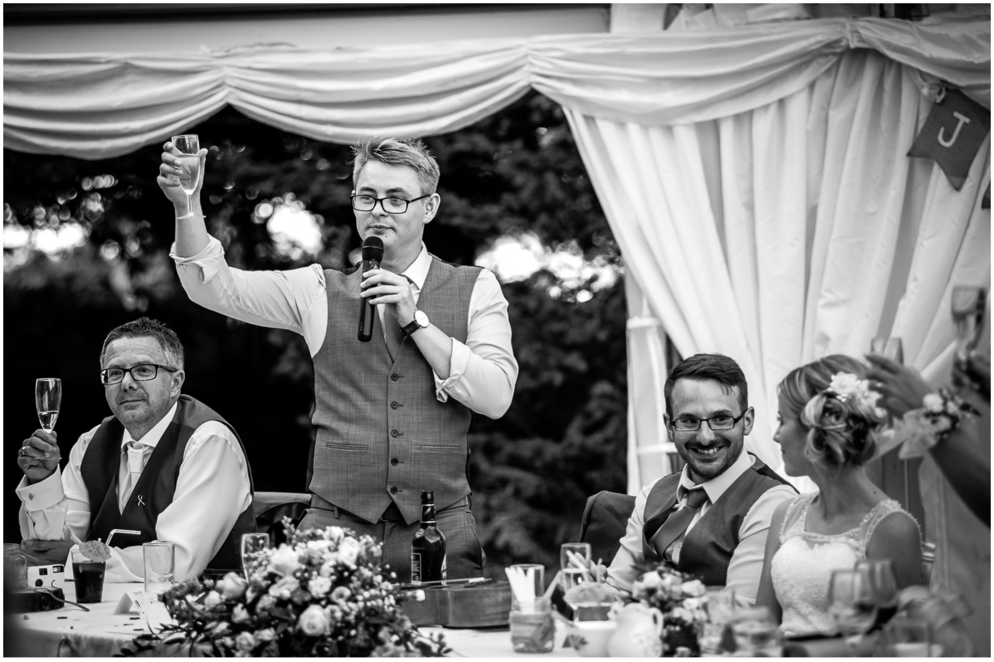 Tournerbury Woods Estate Wedding Best Man raising a toast