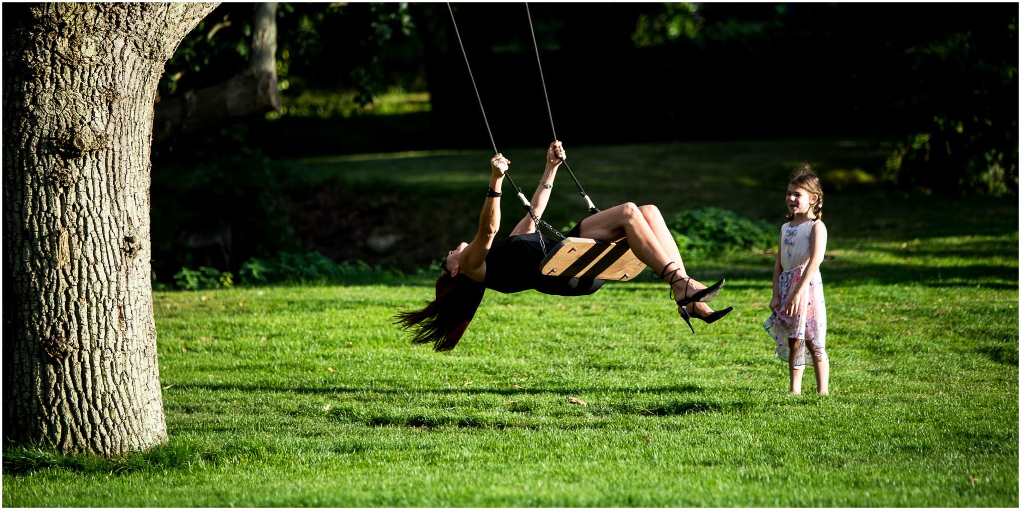 Tournerbury Woods Estate Wedding Guest on swing