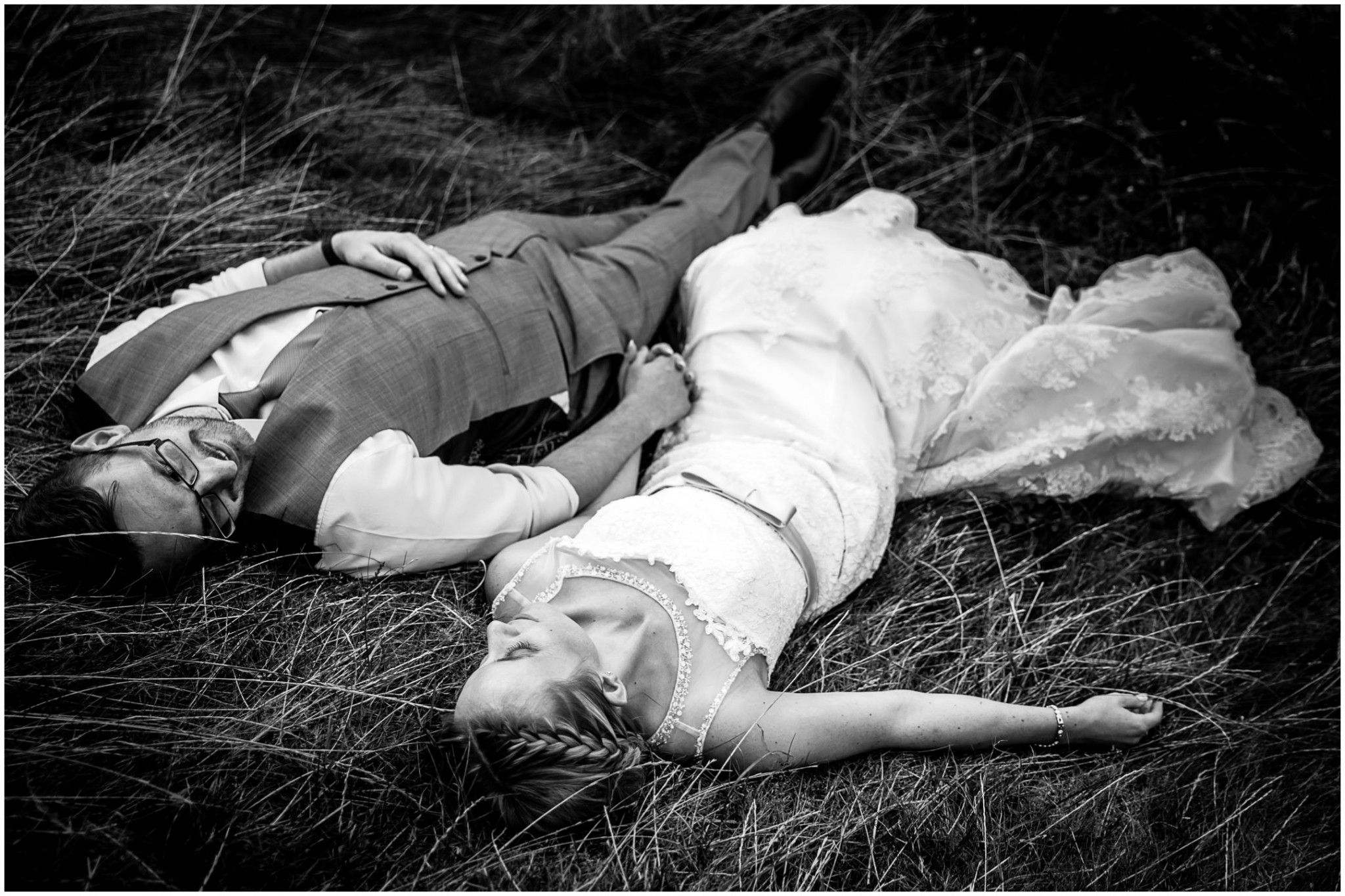 Tournerbury Woods Estate Wedding Bride & Groom lying in long grass