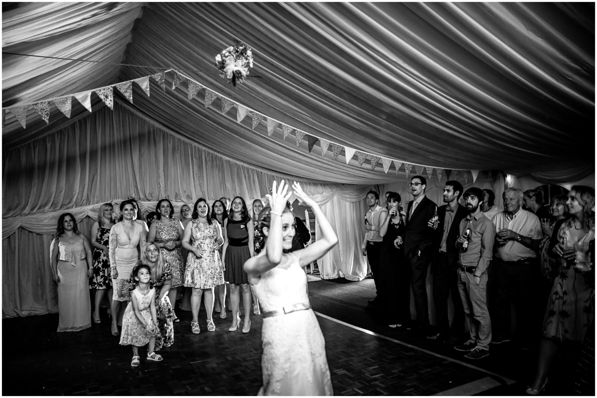 Tournerbury Woods Estate Wedding Bride throws the bouquet