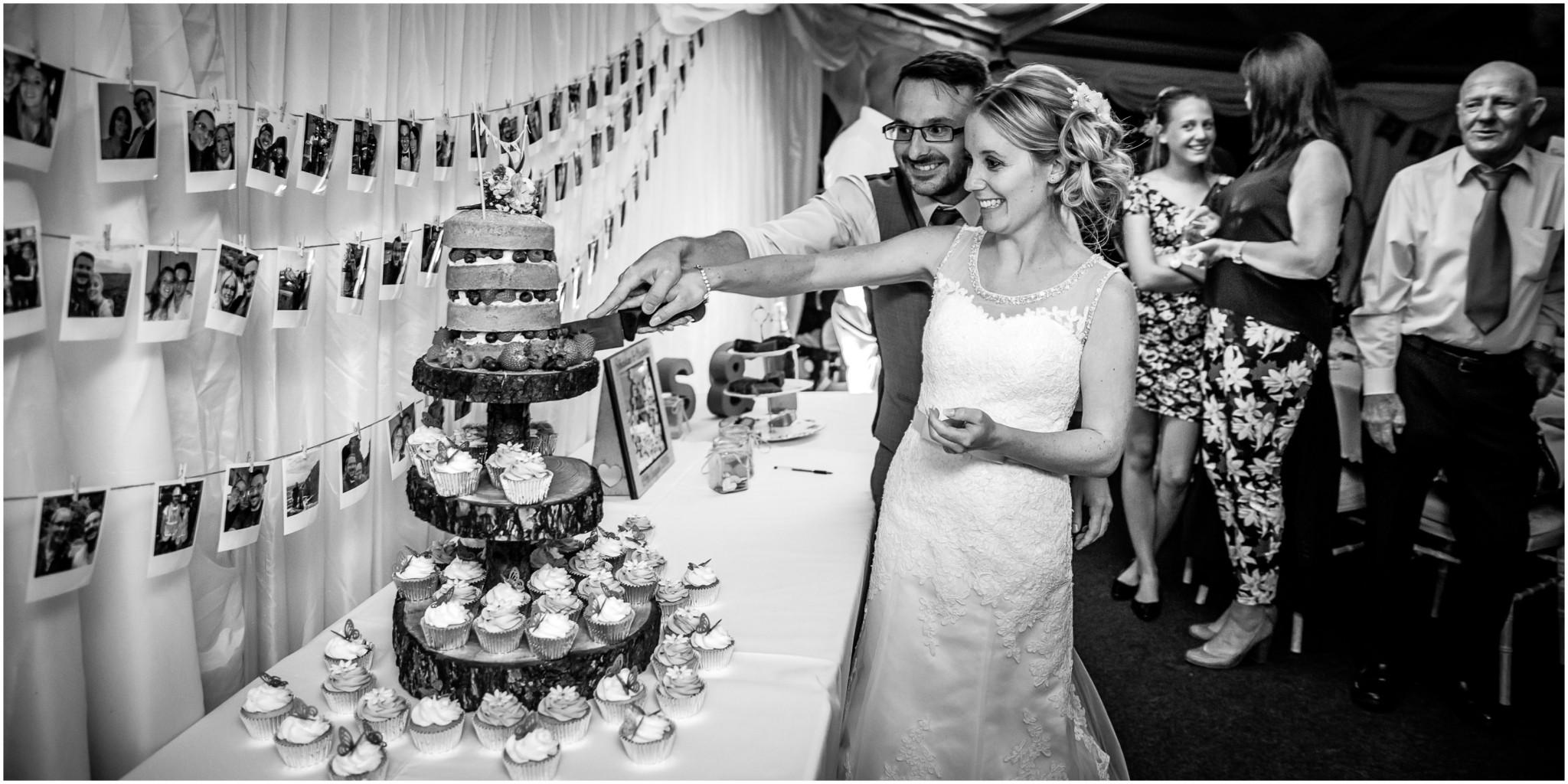 Tournerbury Woods Estate Wedding Cutting the Cake