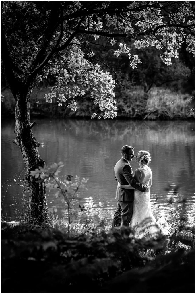 Tournerbury Woods Estate Wedding Bride & Groom overlooking the lake