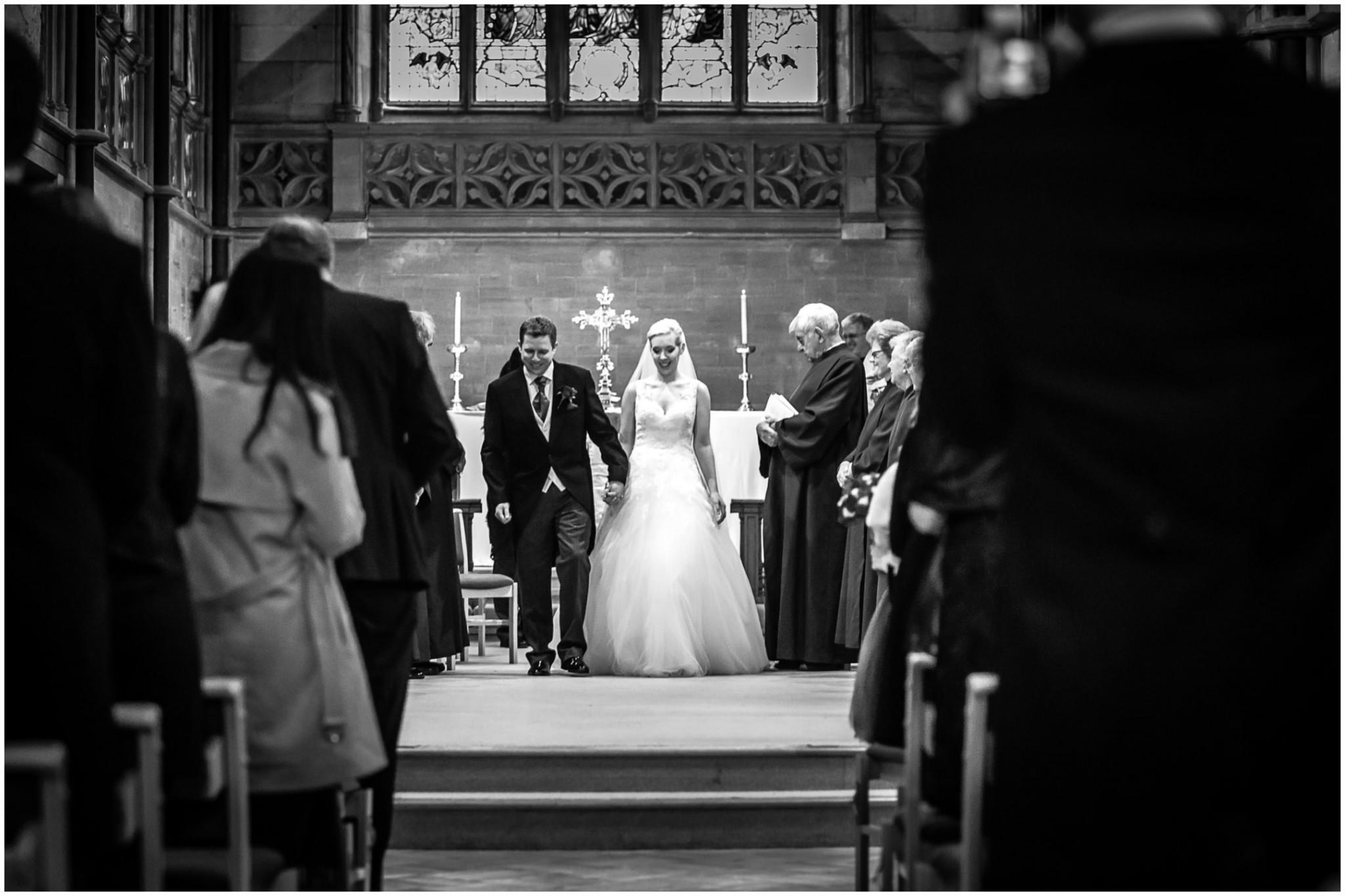 St Saviours Church Brockenhurst Bride & Groom walk down the aisle