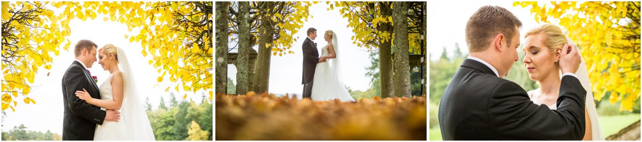 Rhinefield House Wedding Bride & Groom in autumn leaves