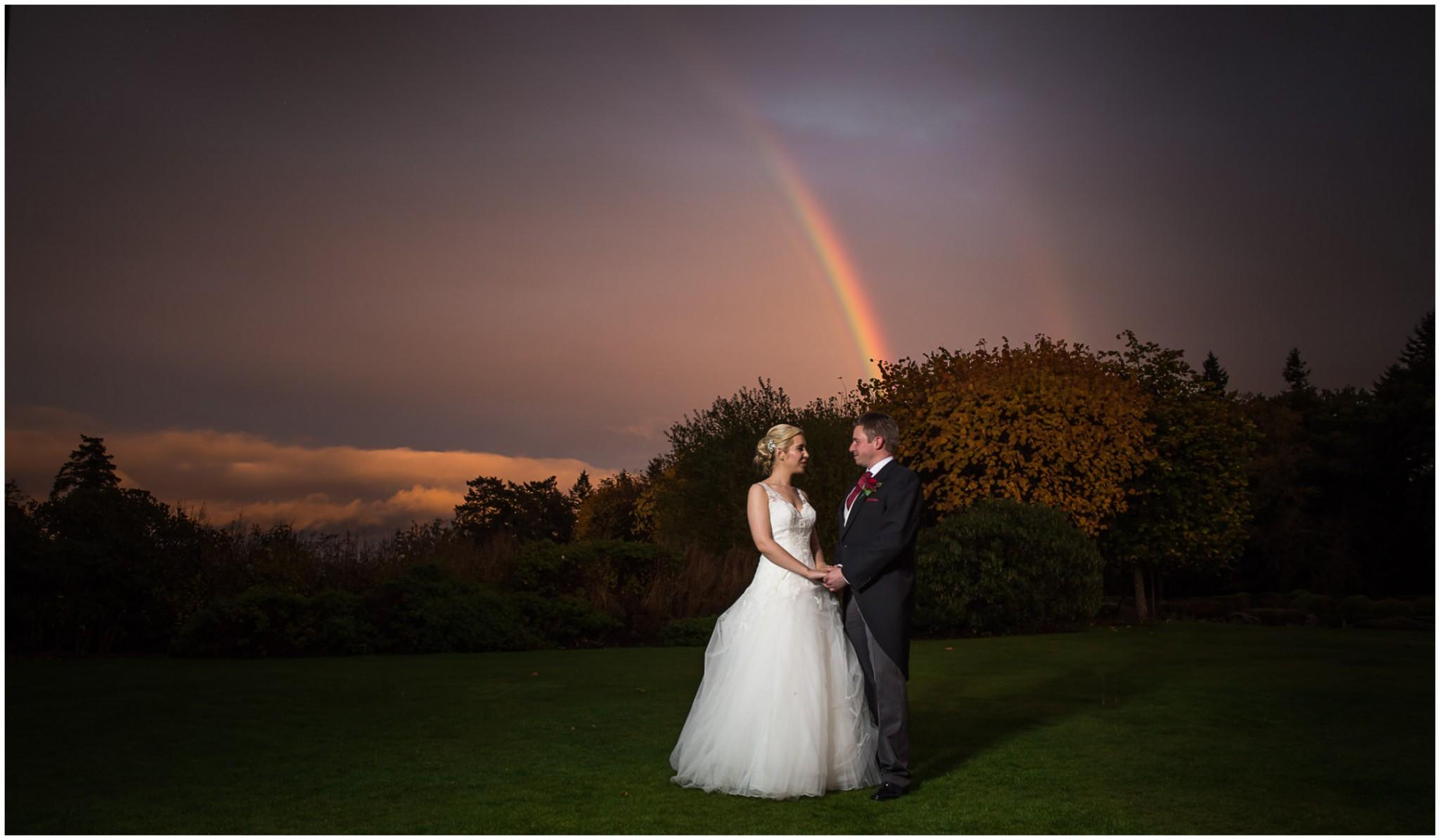 Rhinefield House Wedding Bride & Groom rainbow sunset