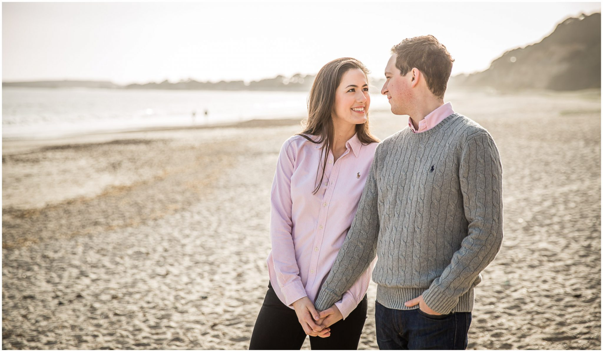 Colour photo of engaged couple on beach in Hampshire UK