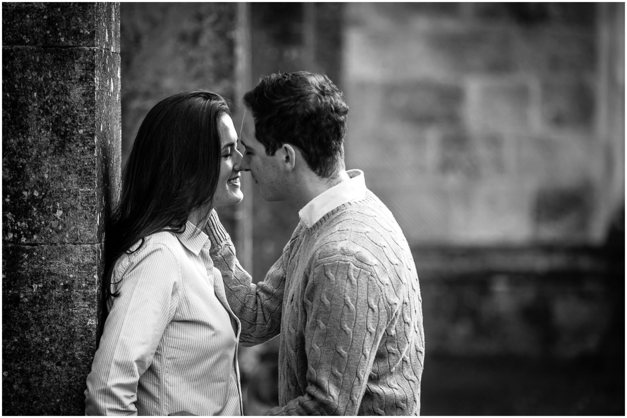 Black and white photo of engagement shoot couple about to kiss