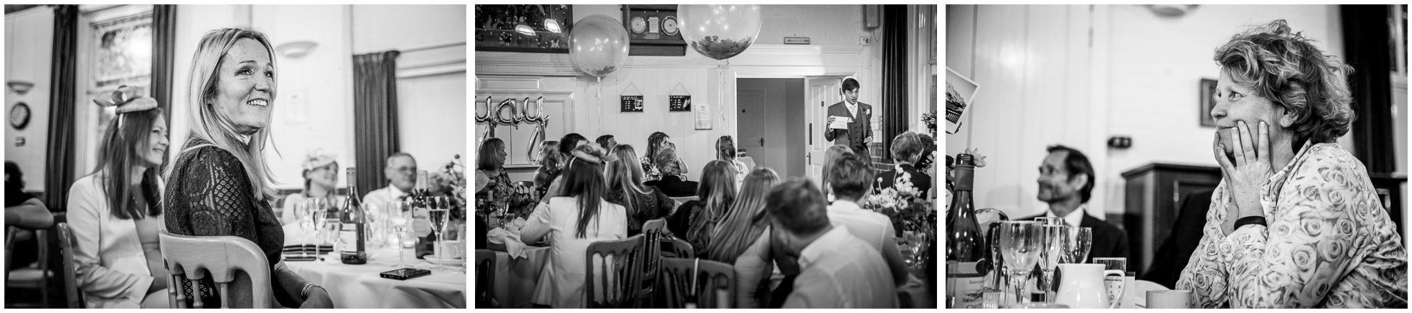 Wedding guests watch the best man's speech