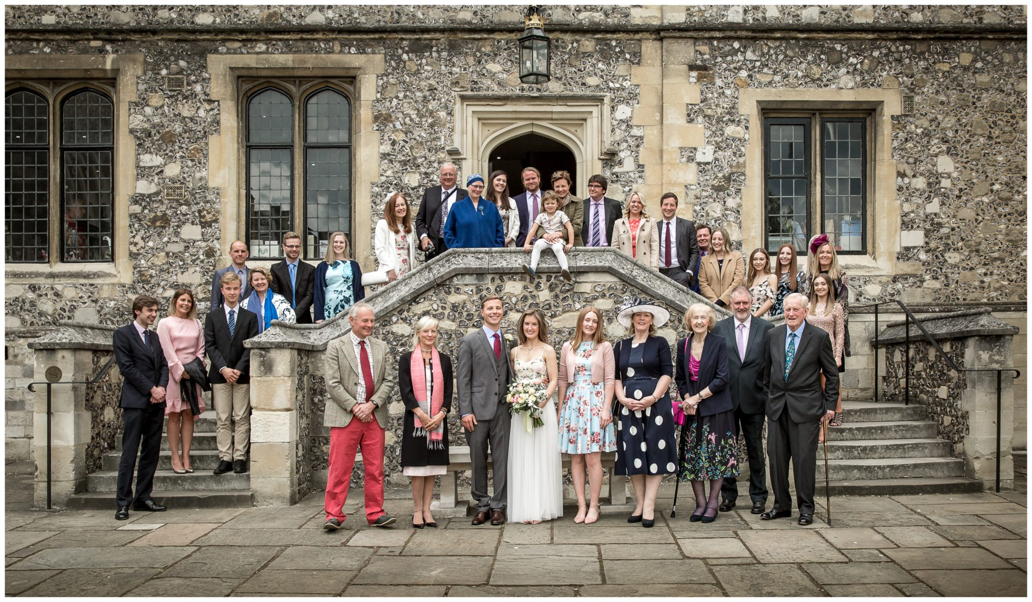 Family group photograph on steps outside Winchester Great Hall