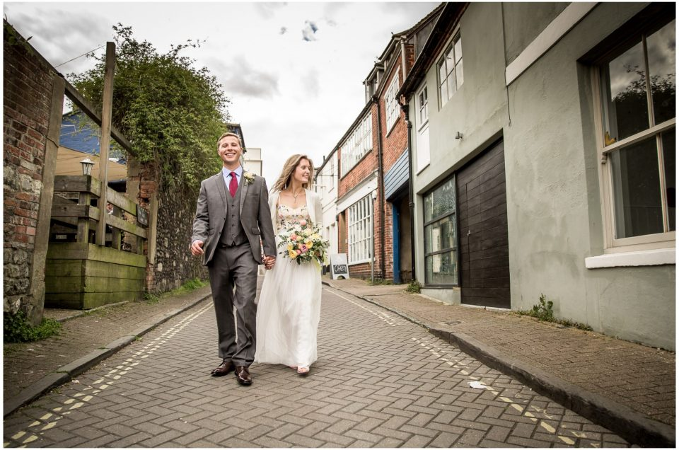 Bride and groom walking through Winchester streets