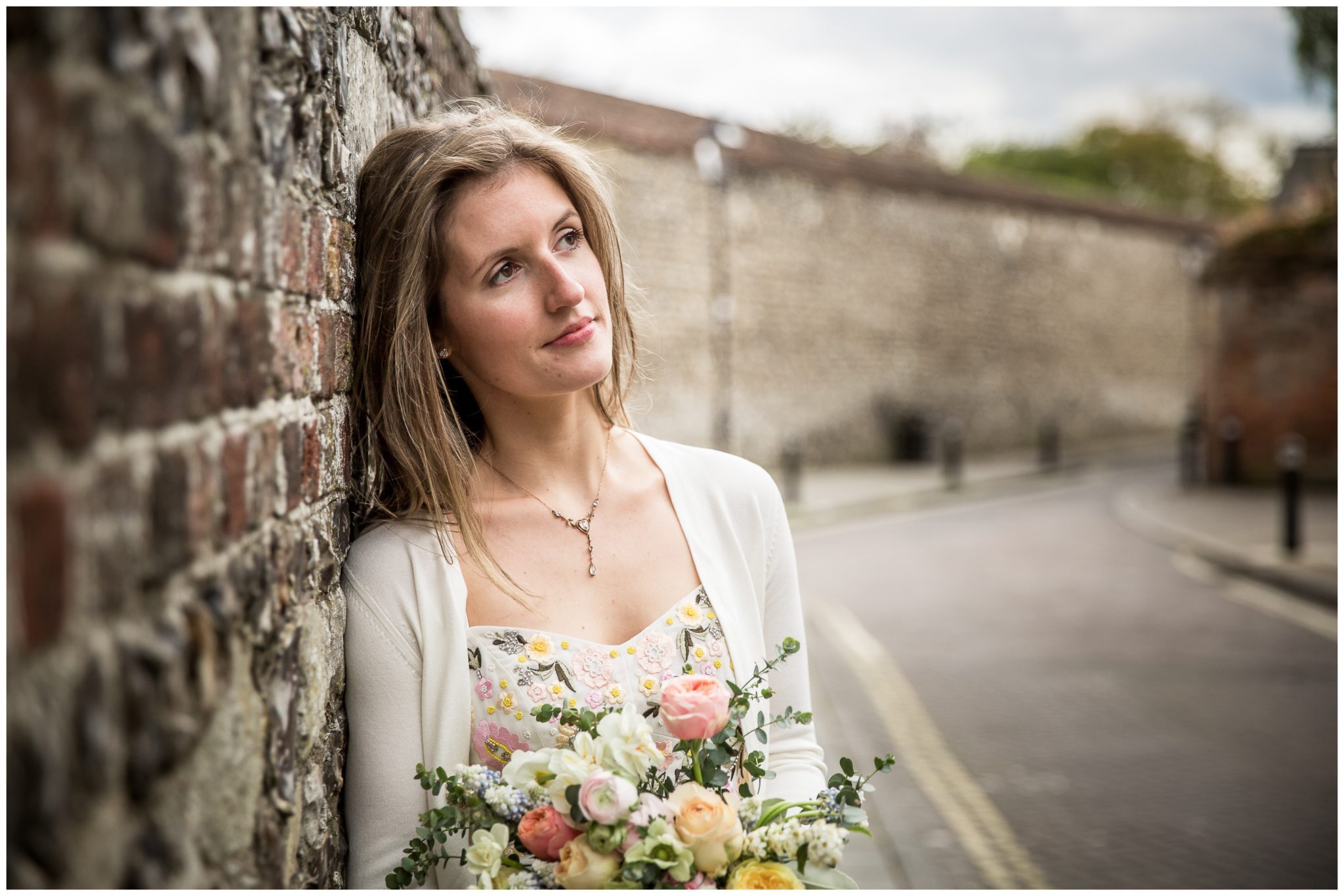 Bridal portrait leaning against wall