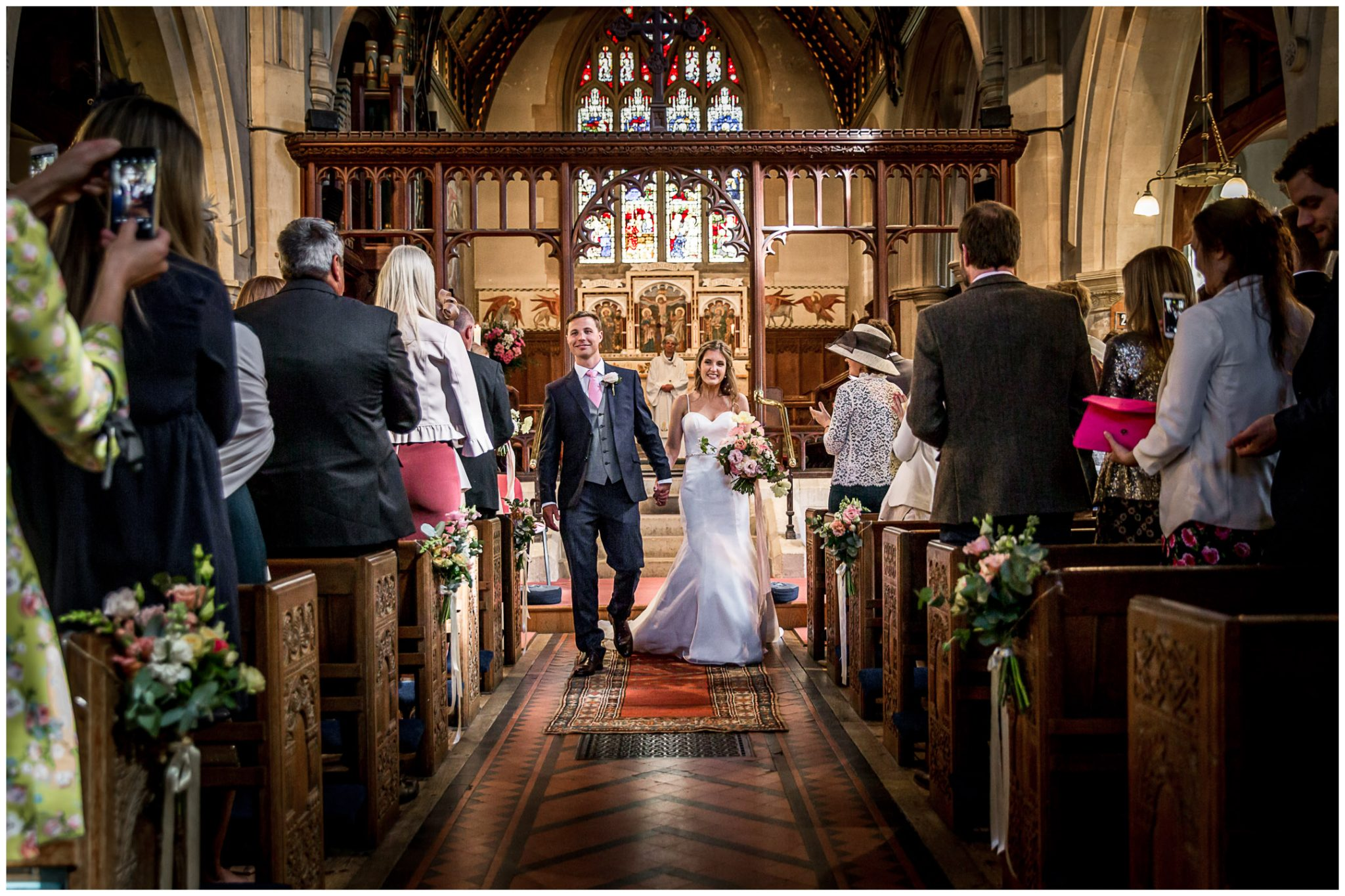 Newly married couple walk down aisle