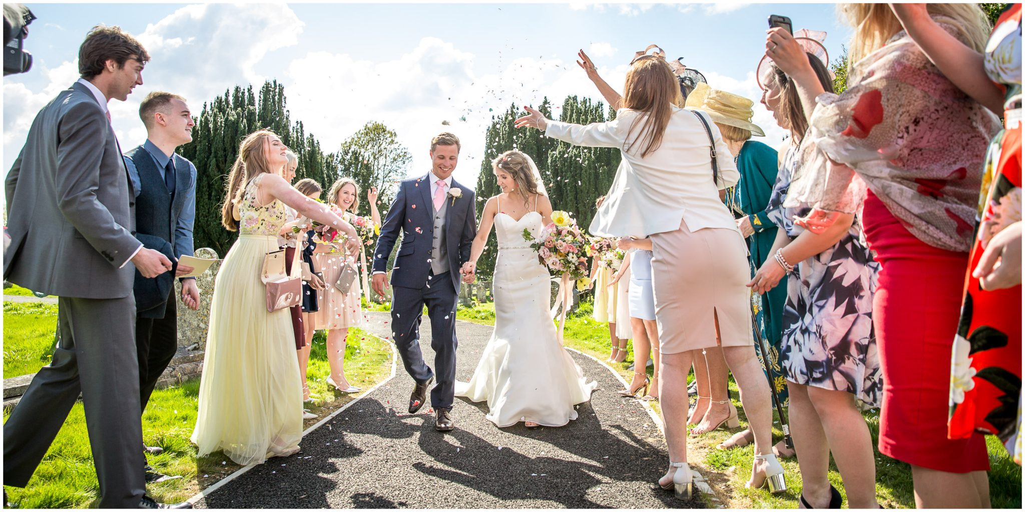 Bride and groom greeted with confetti after wedding