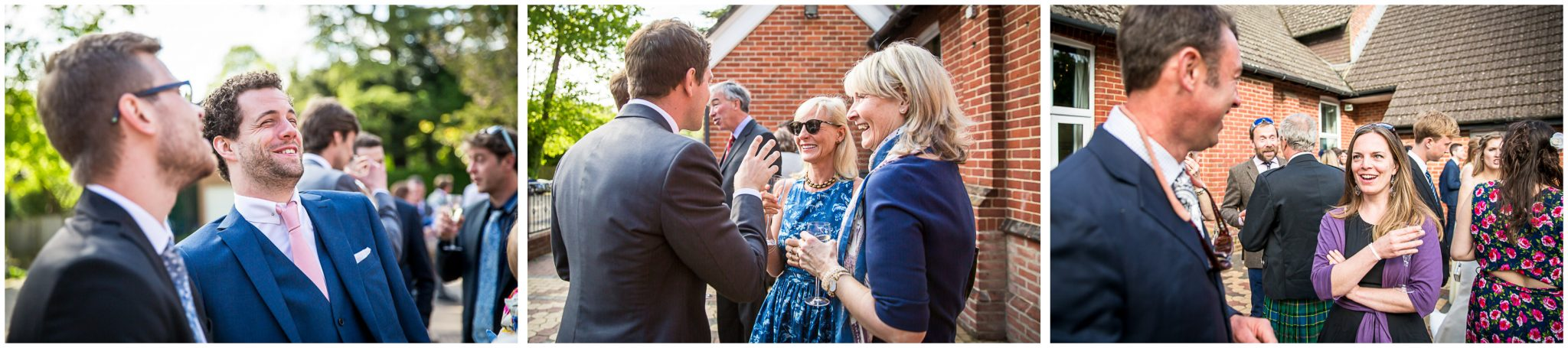 Wedding guests chatting outside village hall reception venue