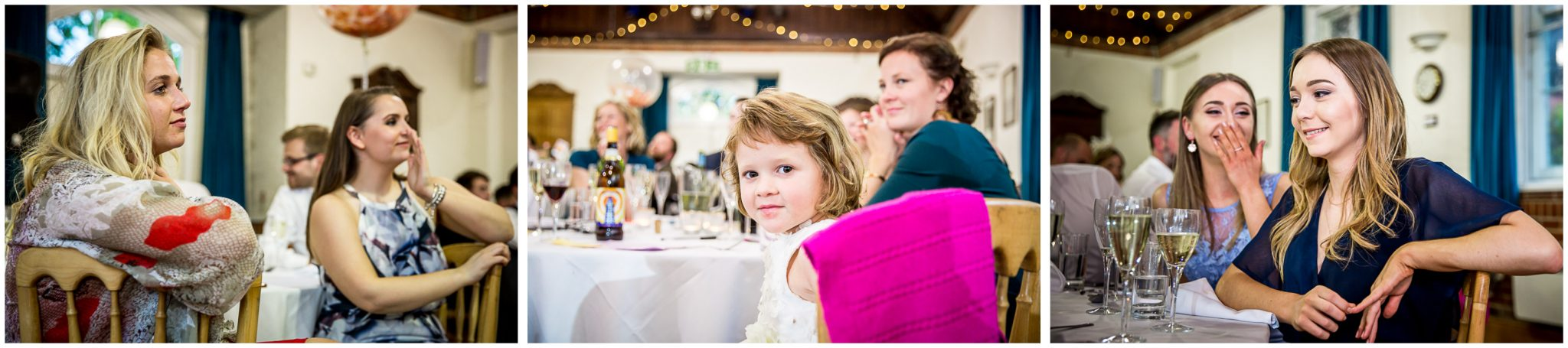 Wedding guests watching the speeches at village hall reception