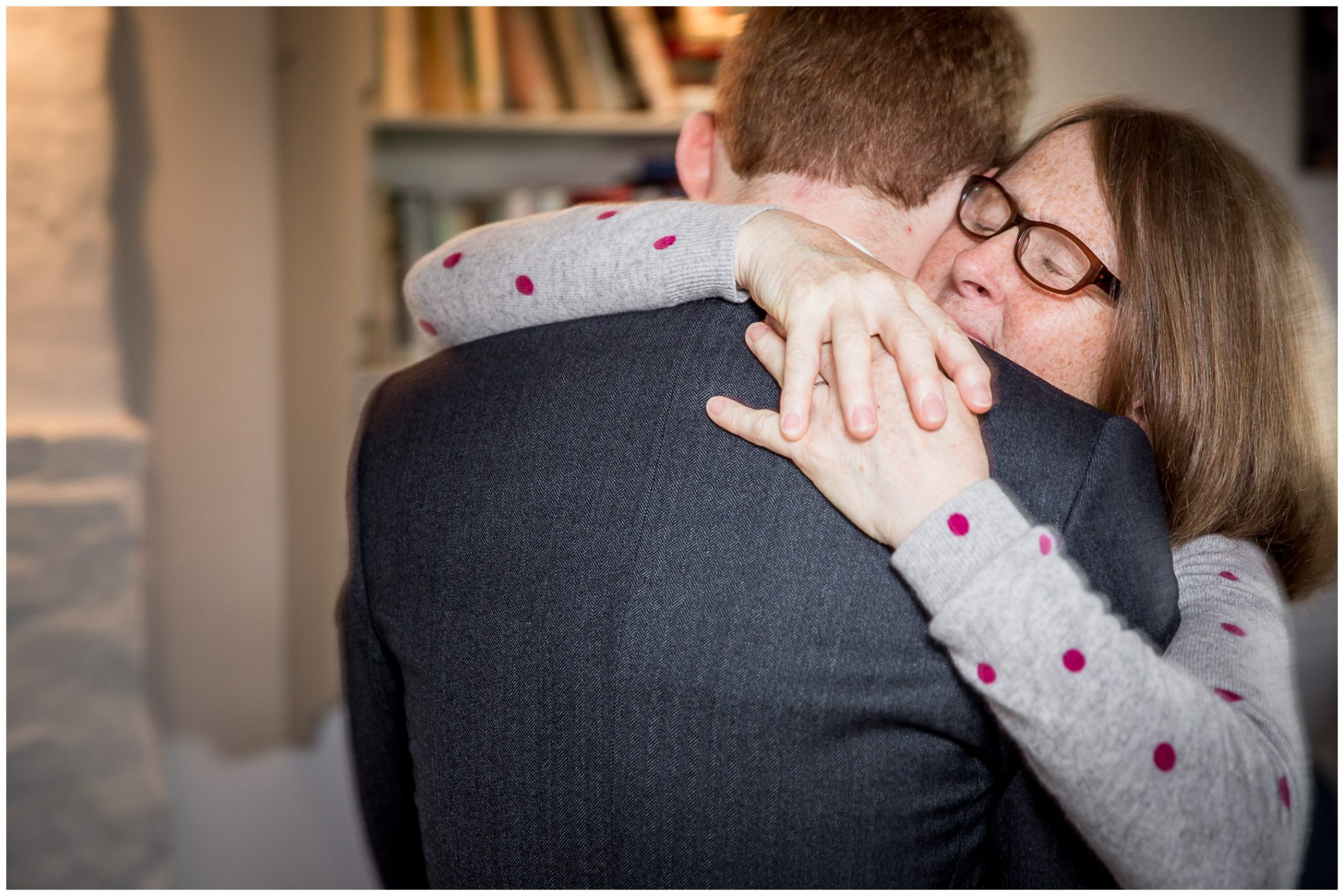 Mother of the groom hugs her son before he departs for the church