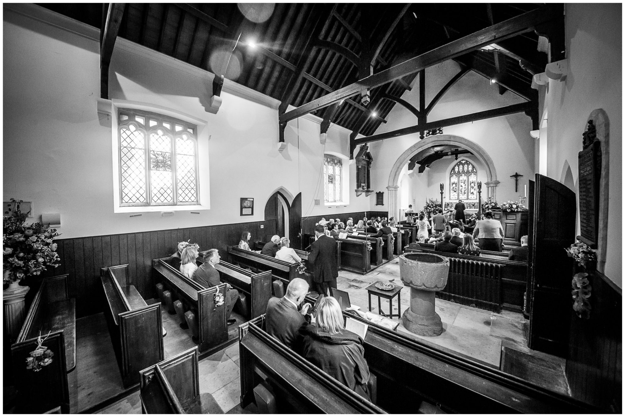 Black and white photograph of inside St Peters Church, Hinton St Mary