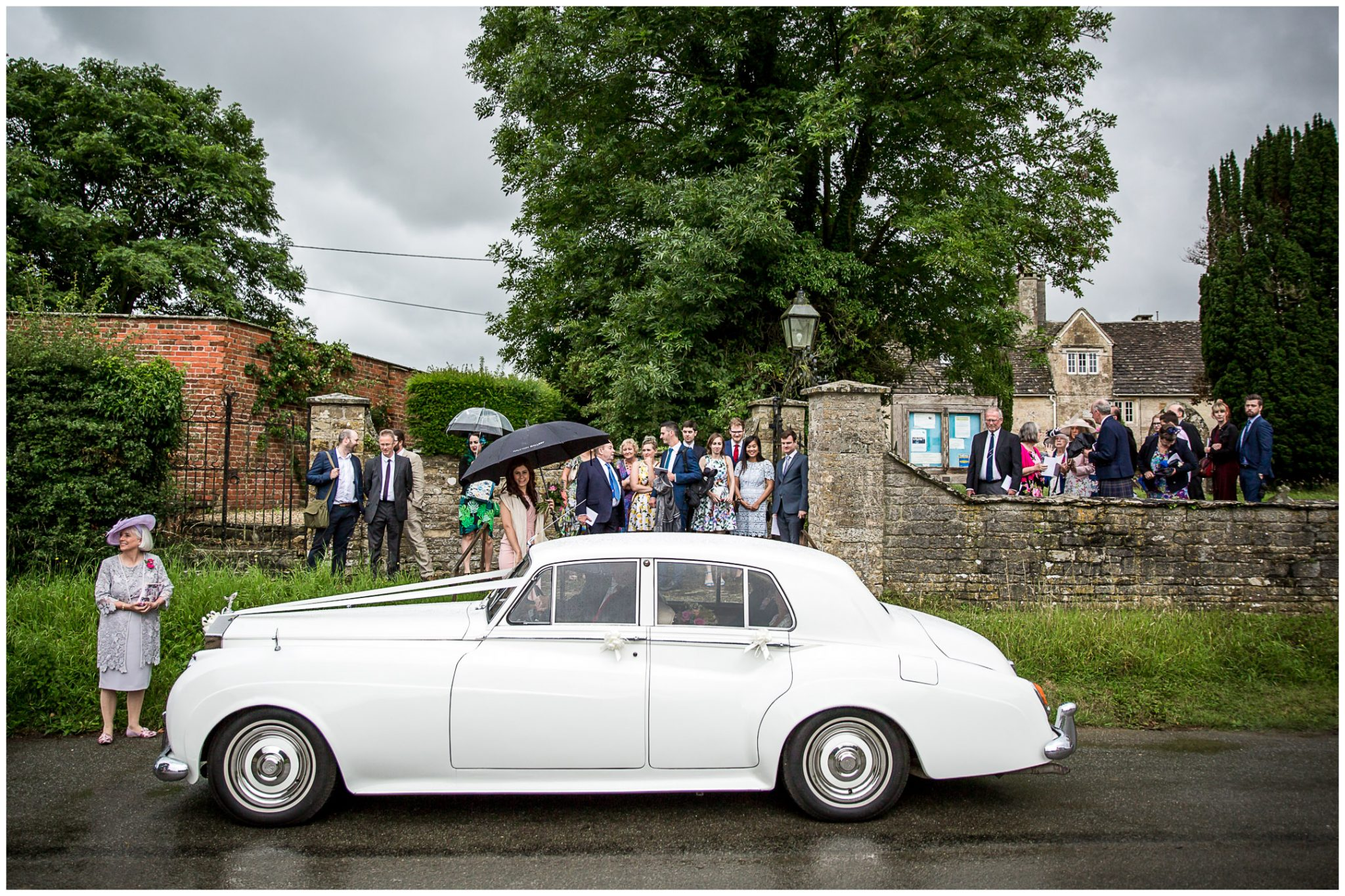The wedding car departs the church for the reception venue