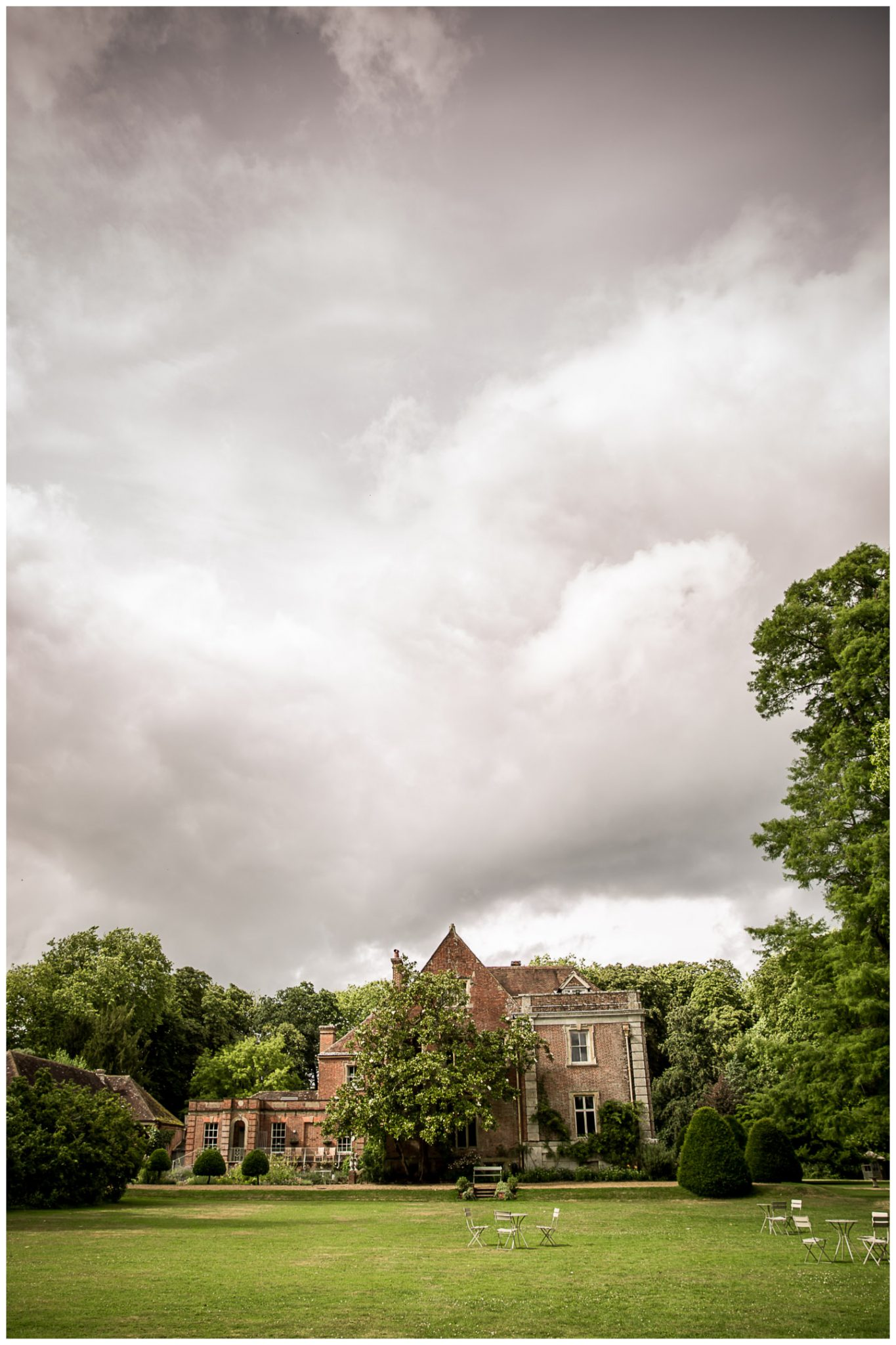 Photograph of the rear of the house in Wimborne as the clouds roll in