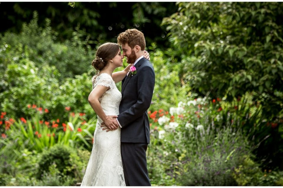 Bride and groom in gardens at Deans Court Dorset wedding venue