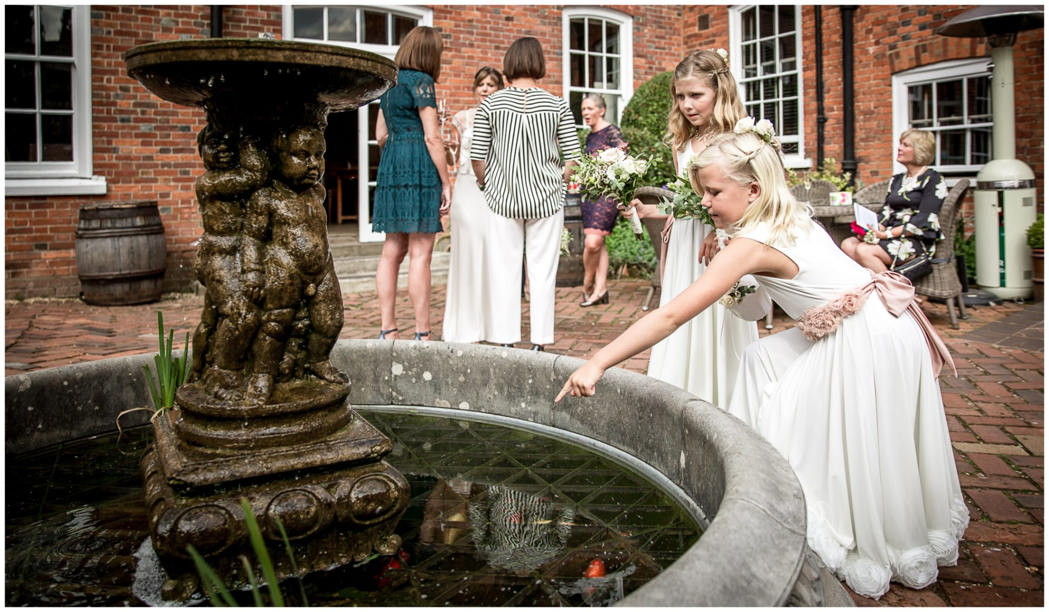 Flower girls in garden of Winchester Hotel du Vin