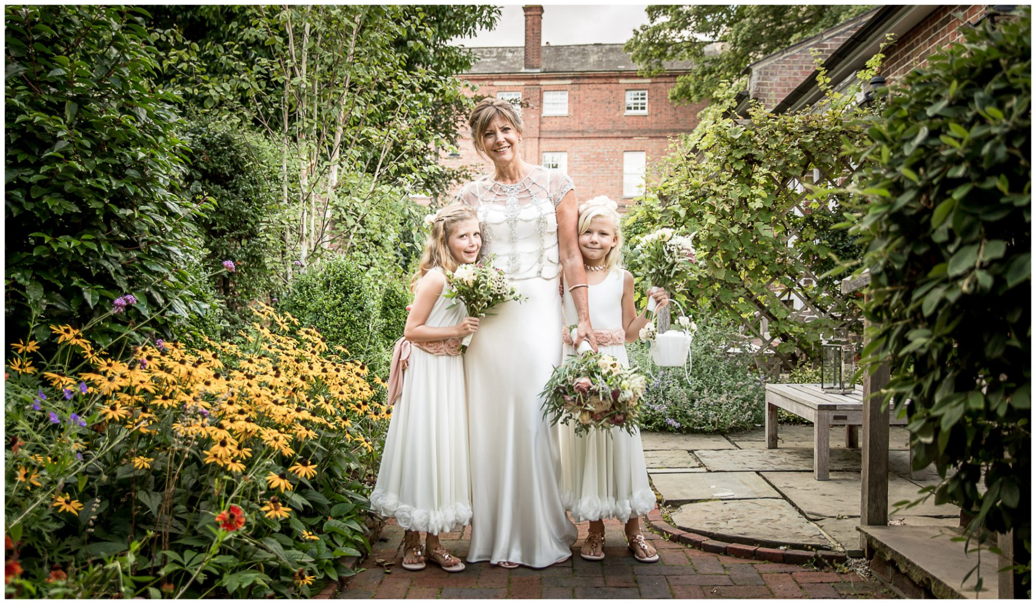 Bride with daughters in grounds of Hotel du Vin WInchester