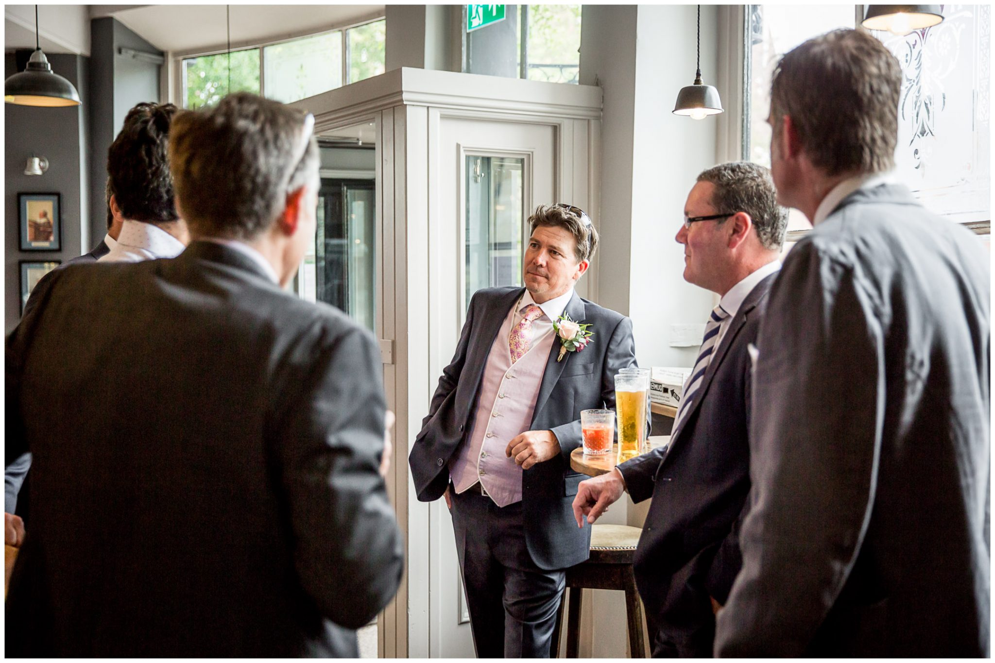 Groom with friends having pre-ceremony drink