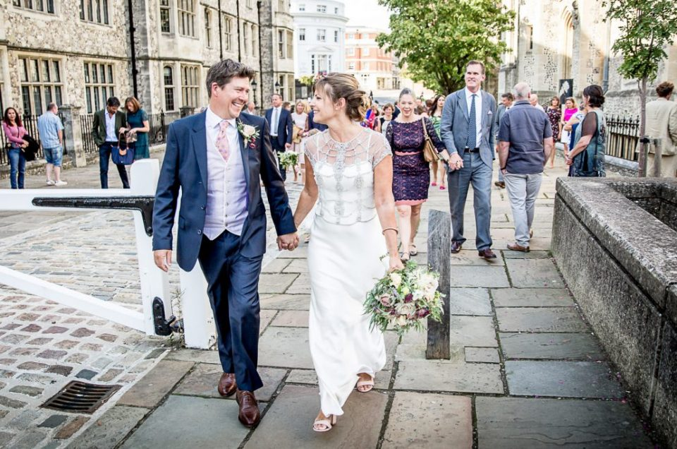 Bride and groom walking together after Castle Room marriage ceremony in WInchester
