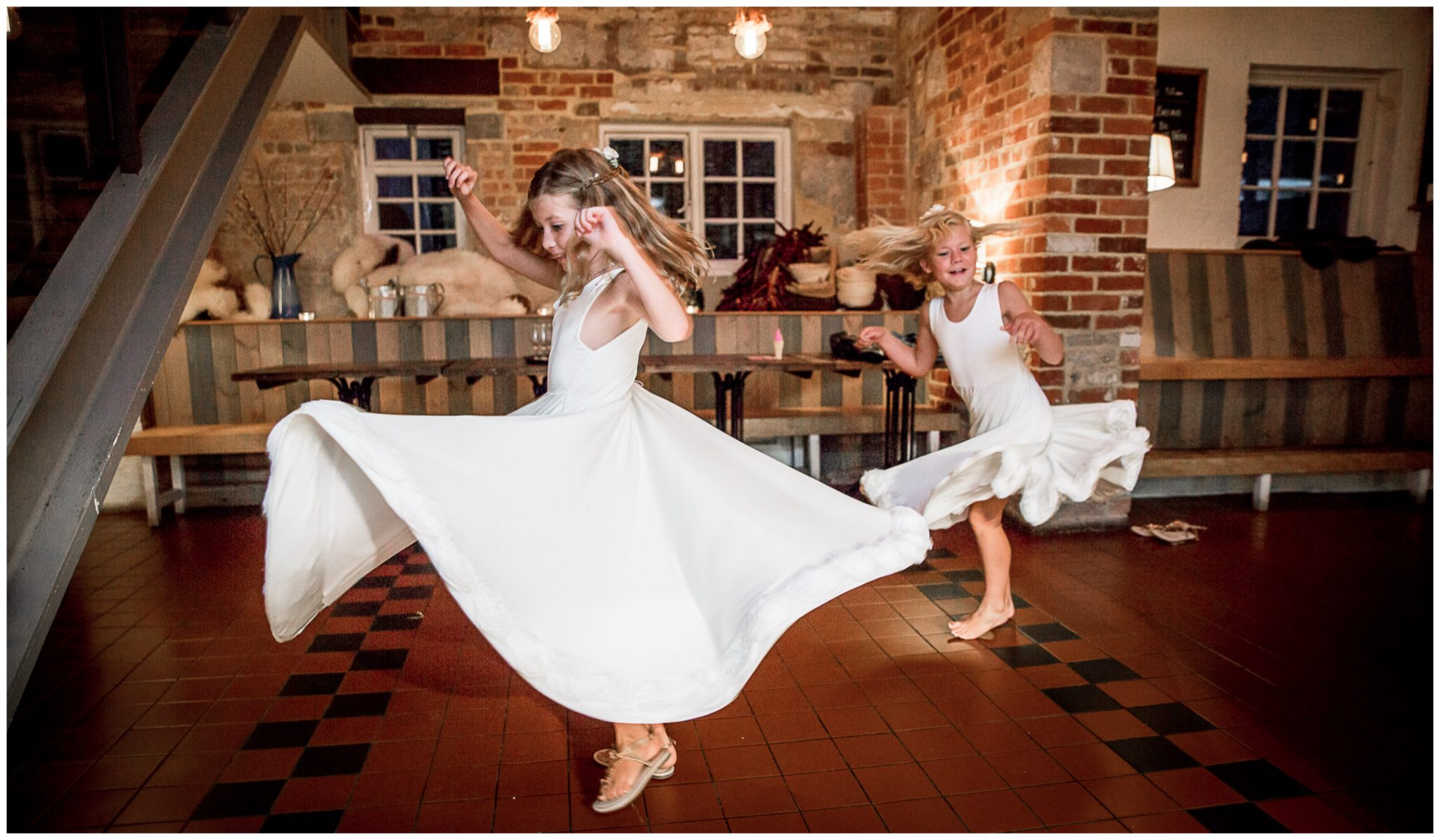 Flower girls dancing at reception party