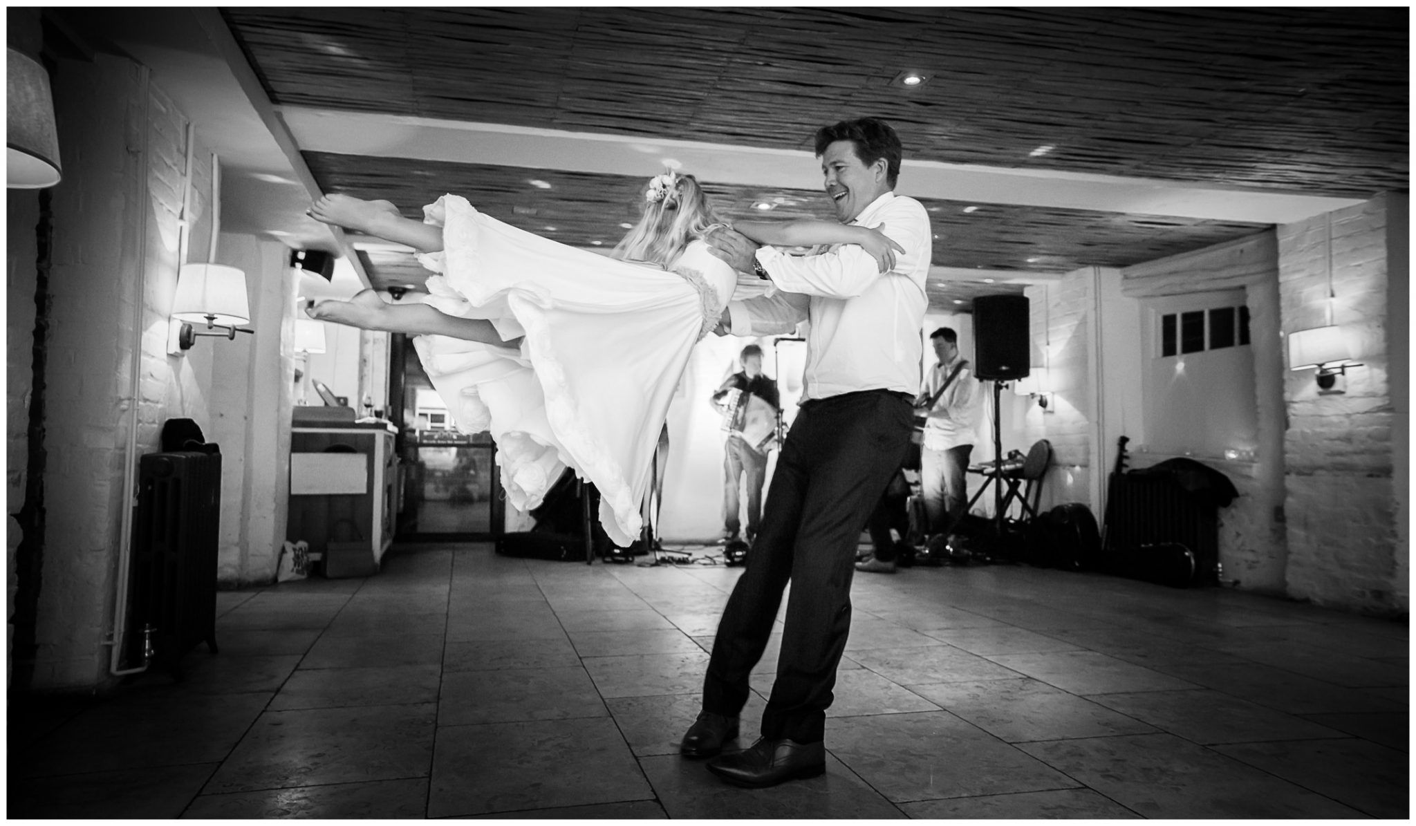 Groom and daughter dancing at wedding reception