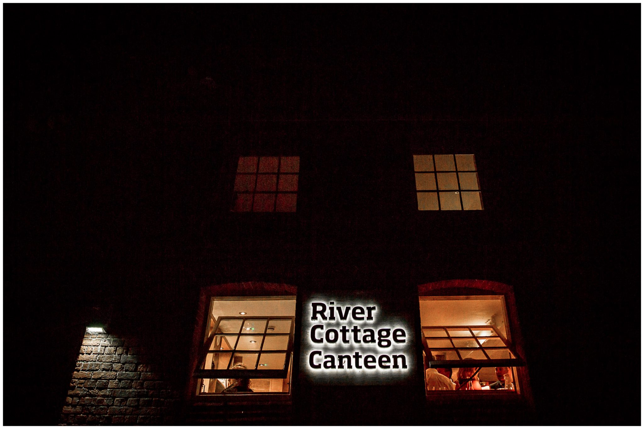 River Cottage Winchester lit up at night