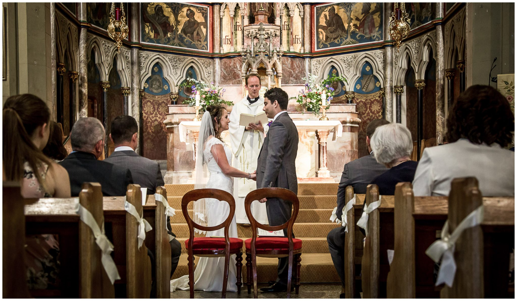Exchange of vows between bride and groom at St Bede's Church Basingstoke