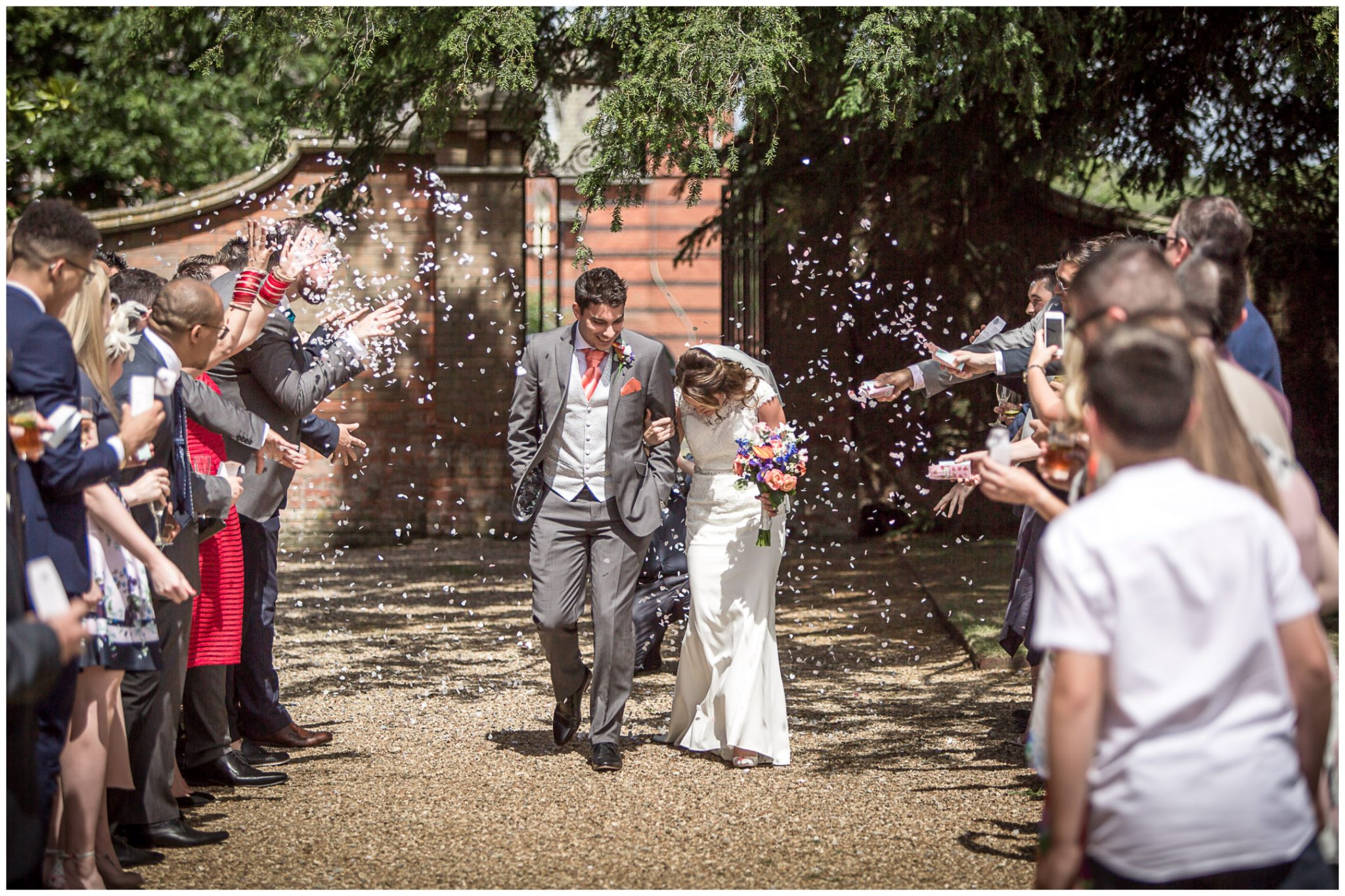 Coloour photo of confetti as bride and groom arrive for reception