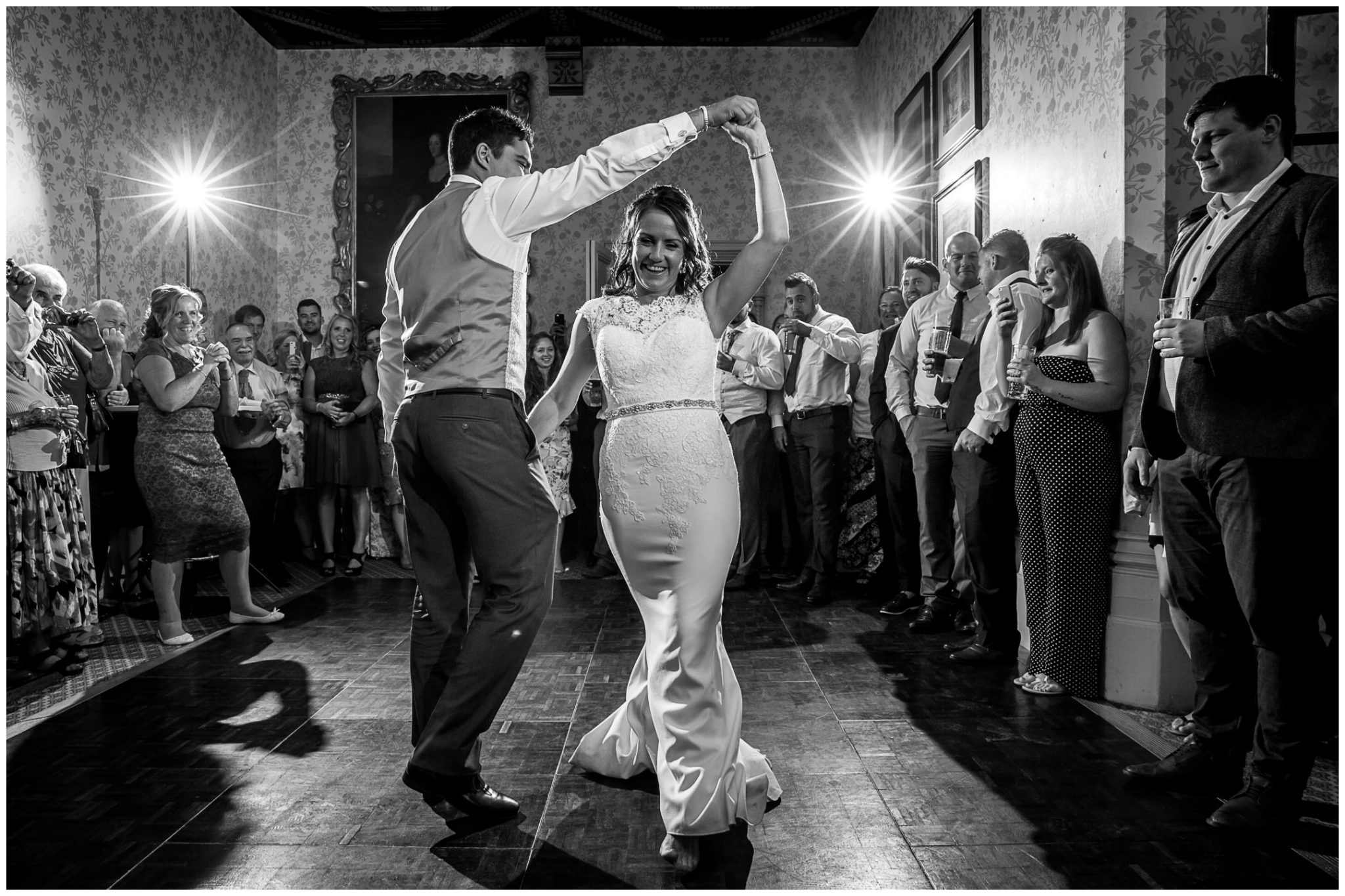 The groom spins his bride around during the first dance at the Elvetham