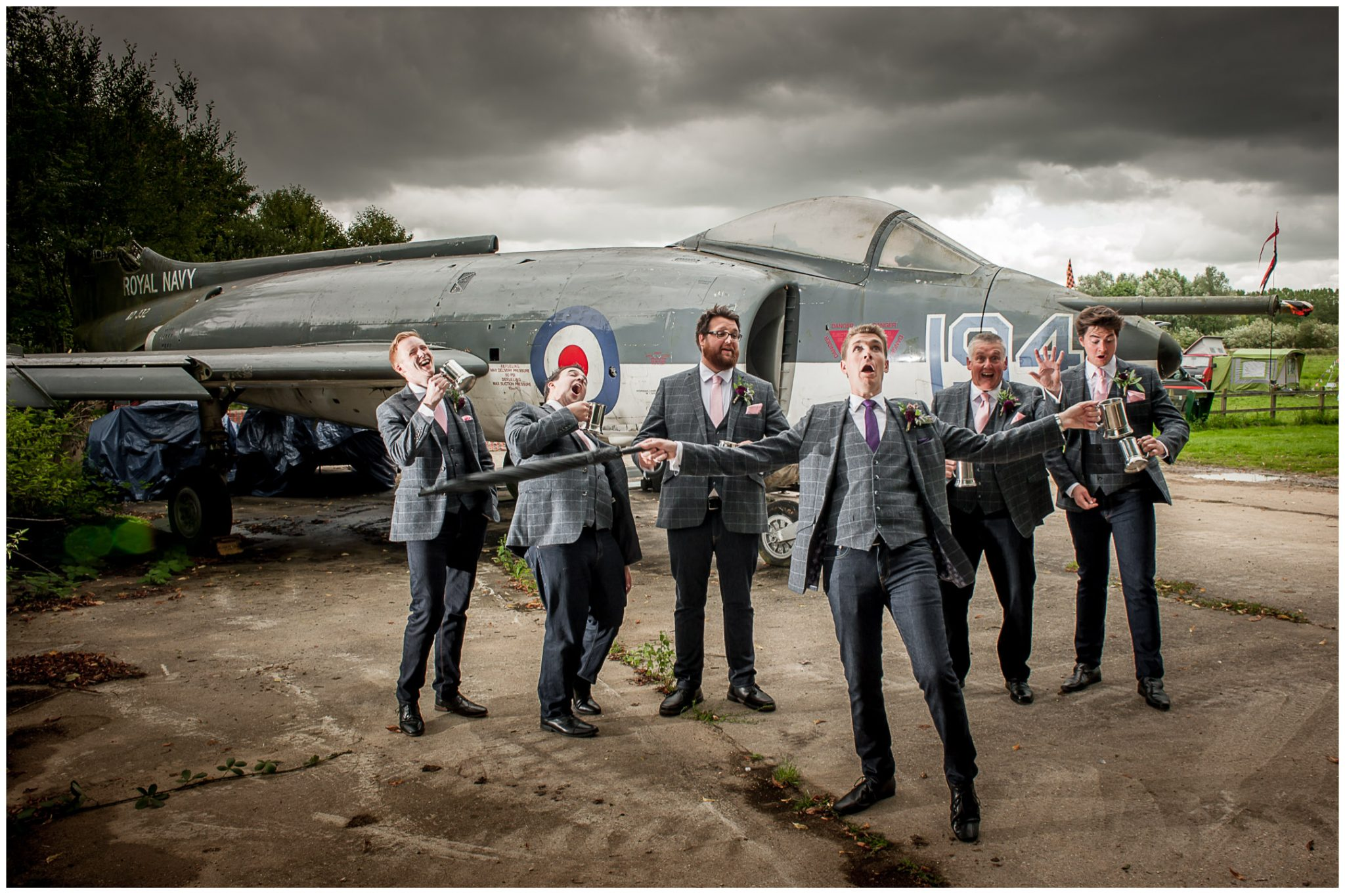 Timsbury Manor Festival Wedding groom and groomsmen under stormy skies